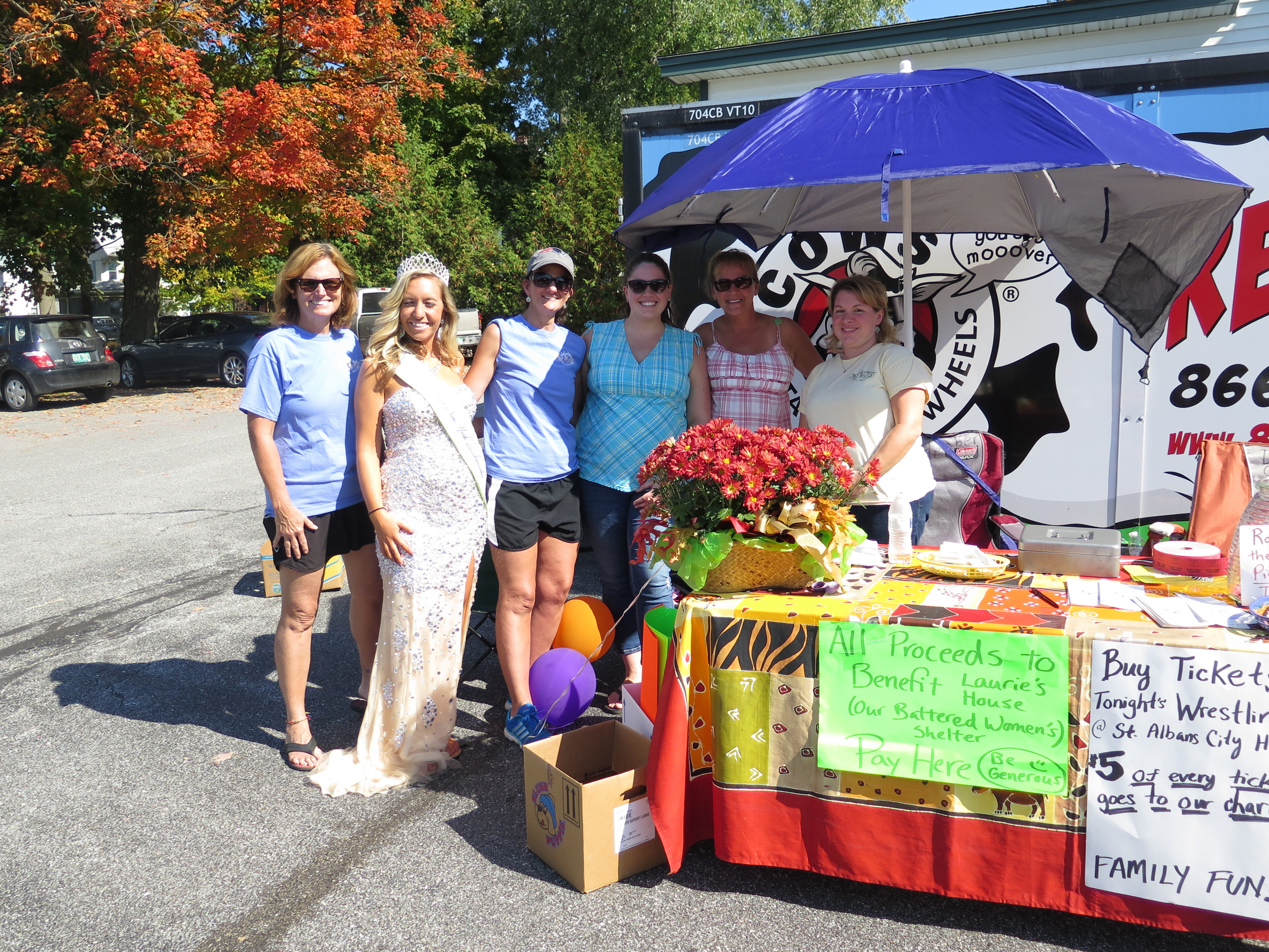 Every year we host a city-wide yard sale to benefit our battered women's shelter. on this day in 2014, for some reason, a beauty queen came by for a while and graced the event! (we never did figure out why she was walking around town randomly!)
