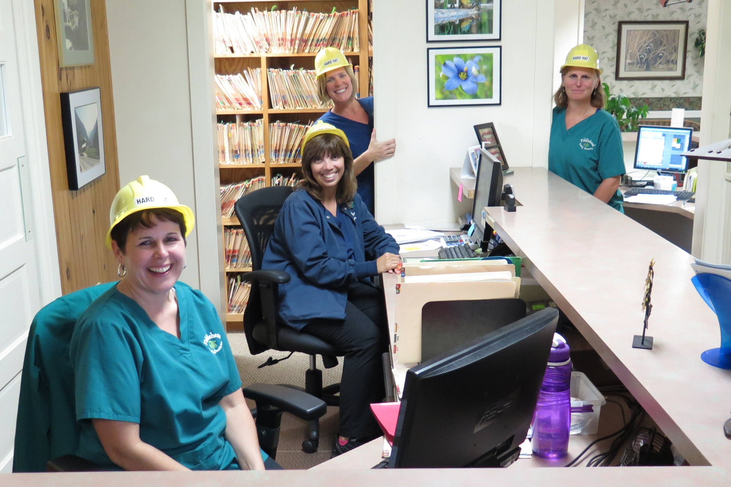 the team wears their hard hats for fun on the day that we had almost no septic access. This is typical of our team: making lemonade out of lemons!