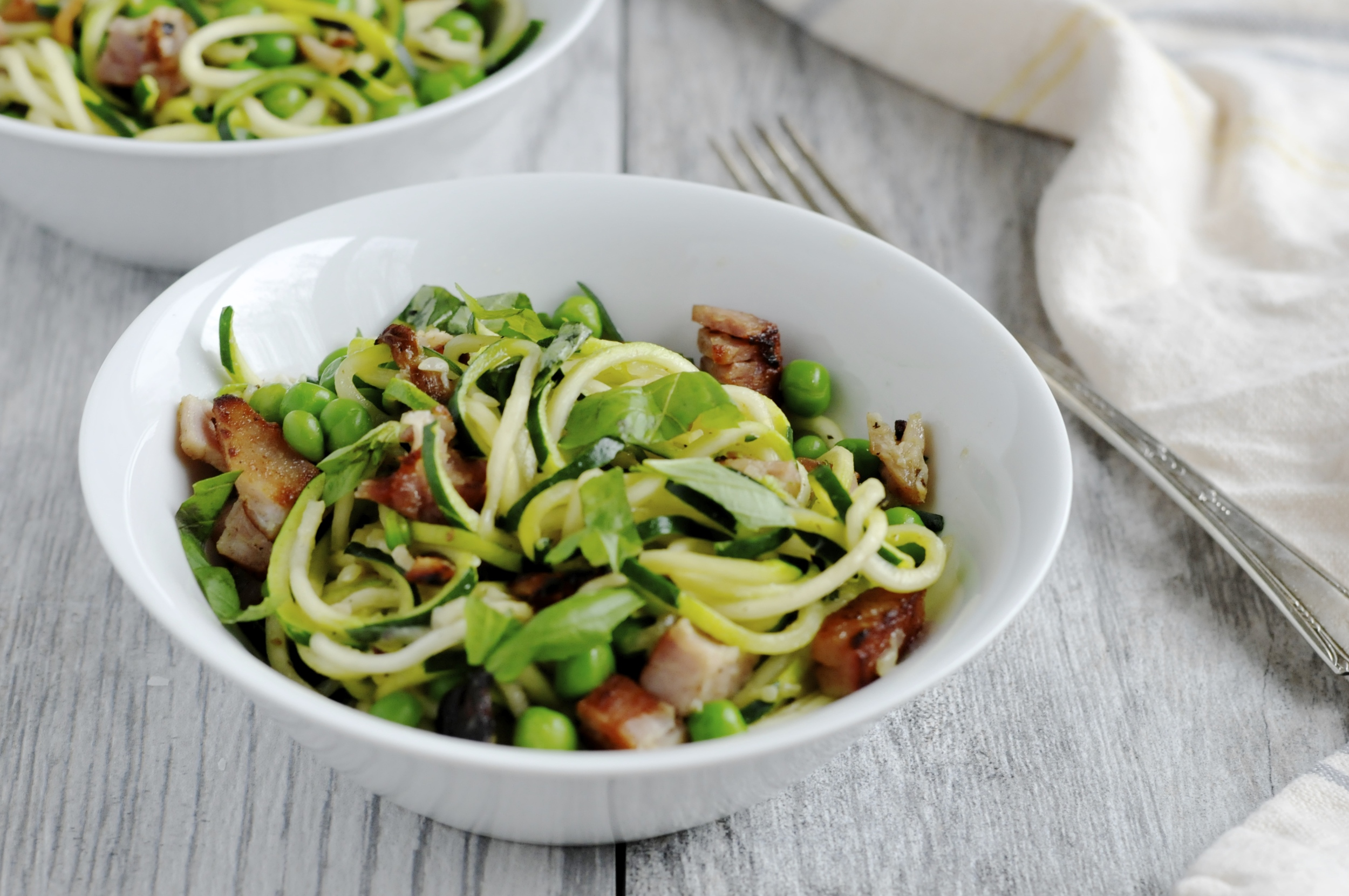 Zoodles with ham, peas and basil
