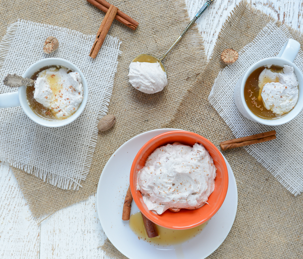 Pumpkin Spice Coconut Whipped Cream is naturally dairy-free, refined sugar-free and perfect stirred into coffee, hot cocoa, warm apple cider, on top of pancakes, or on it's own directly out of the bowl! Makes a great replacement for non-dairy creamer, too! #realfoodwholelife #realfoodwholeliferecipe #glutenfree #dairyfree #healthy #clean-eating #fall #fallrecipe #pumpkin #pumpkinrecipe #halloween #halloweenparty #healthyhalloween #thanskgiving #healthythanksgiving #pumpkinspice