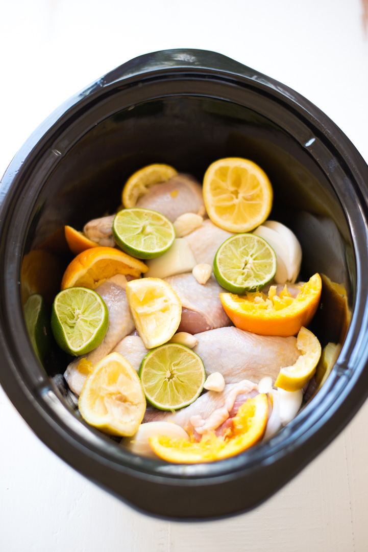Slow Cooker Citrus Chicken (Pollo Asado) yields bright citrus flavors and tender, juicy, fall-off-the-bone chicken. A super easy recipe with delicious results! Paleo and Whole30 friendly.