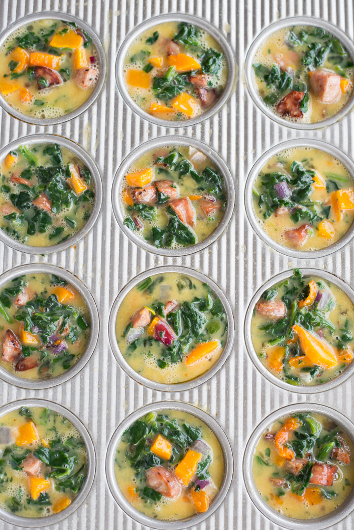 Packed with protein and veggies, these colorful Make-Ahead Butternut, Spinach & Sausage Egg Cups are easy to prepare and make a great grab-and-go breakfast or snack.