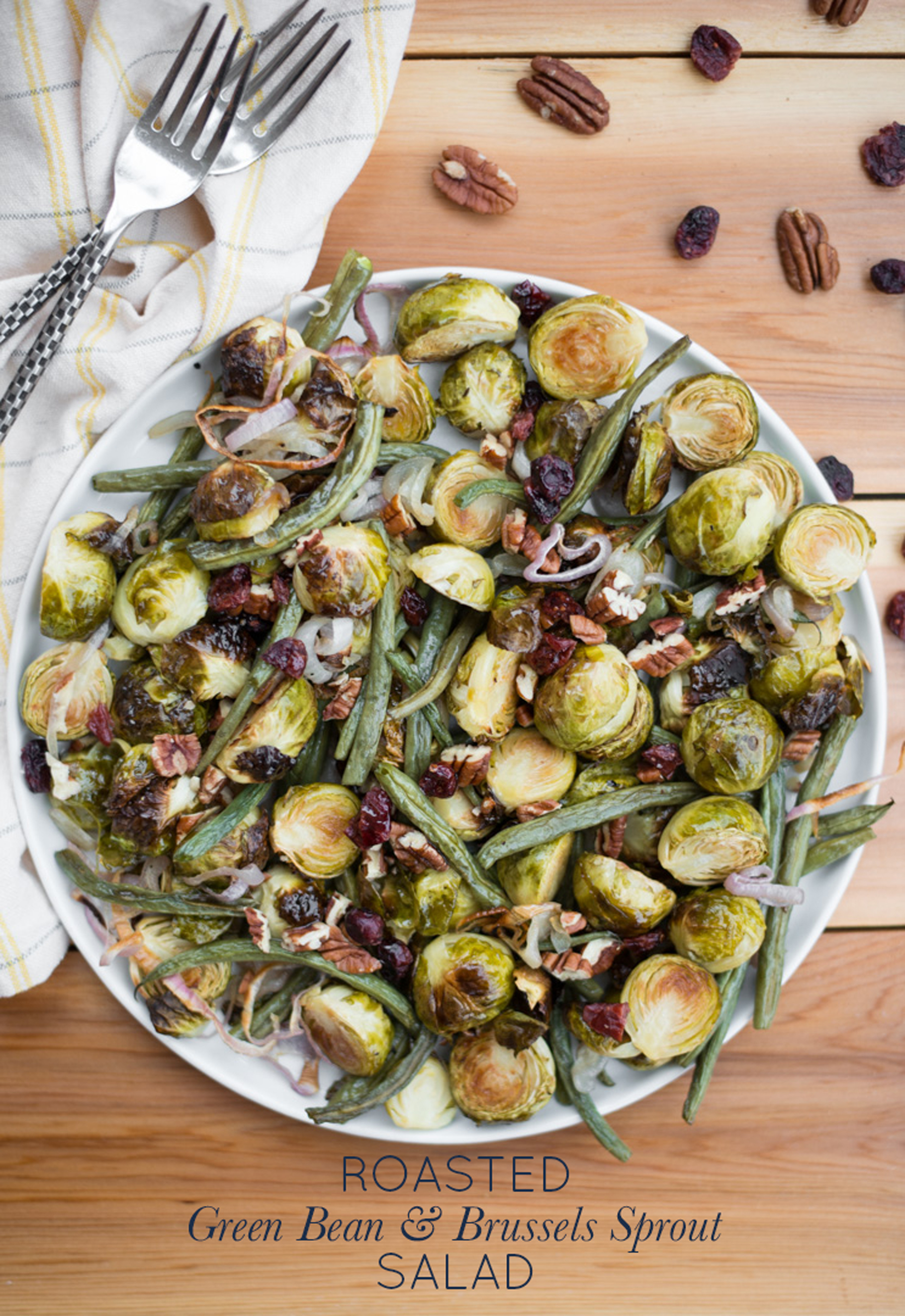 A simple, warming, autumn salad, Roasted Green Bean & Brussels Sprout Salad is hearty, nourishing, and packed with flavor. The perfect side for Thanksgiving dinner or any night of the week!
