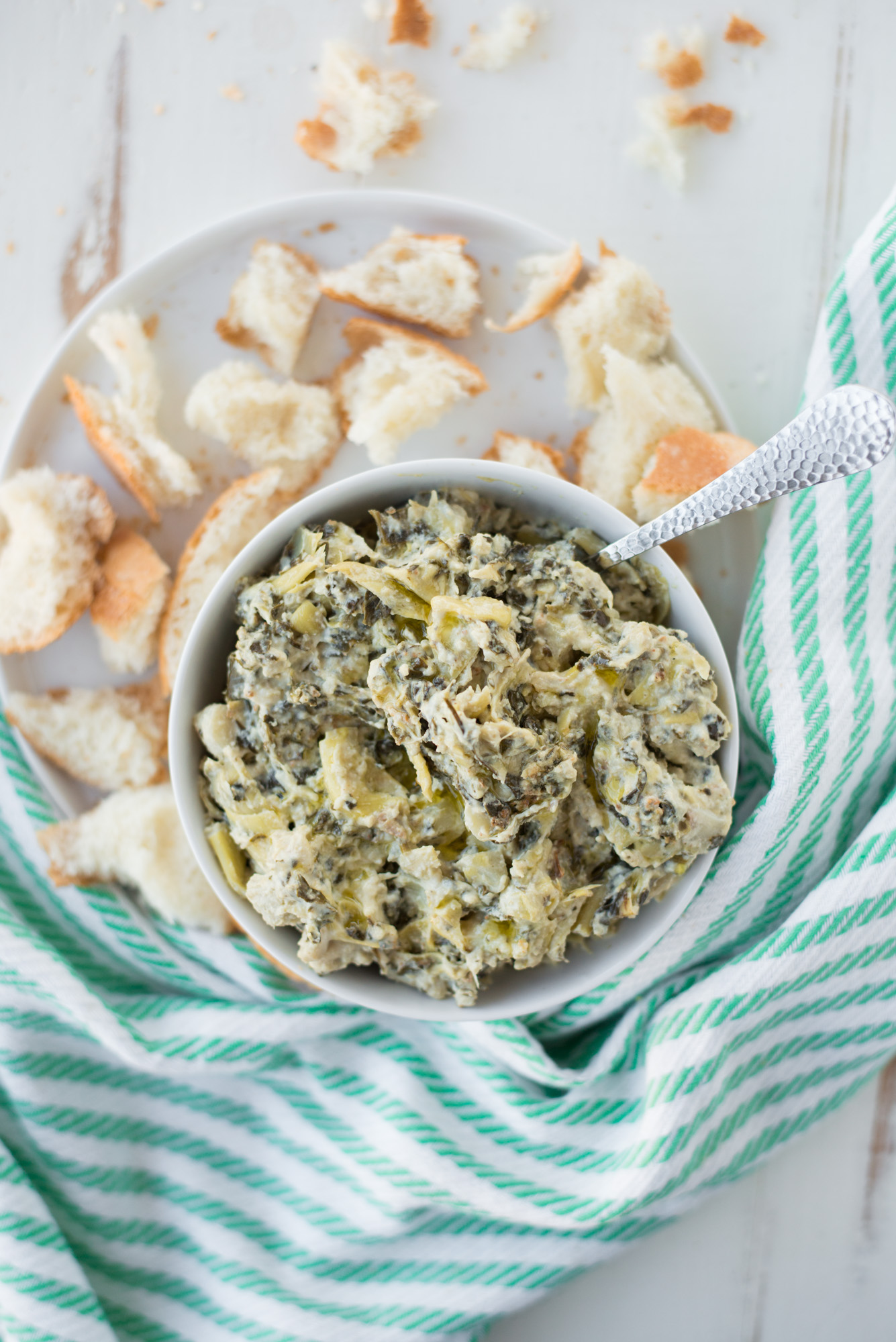 Rich, creamy, and oh-so delicious, Slow Cooker Spinach Artichoke Dip (Dairy-Free, Gluten-Free) will be the hit of your next party or gathering! #realfoodwholelife #healthy #recipe #realfood #cleaneating #glutenfree #dairyfree #soyfree #grainfree #paleo #whole30 #instantpot #crockpot #vegetarian #vegan