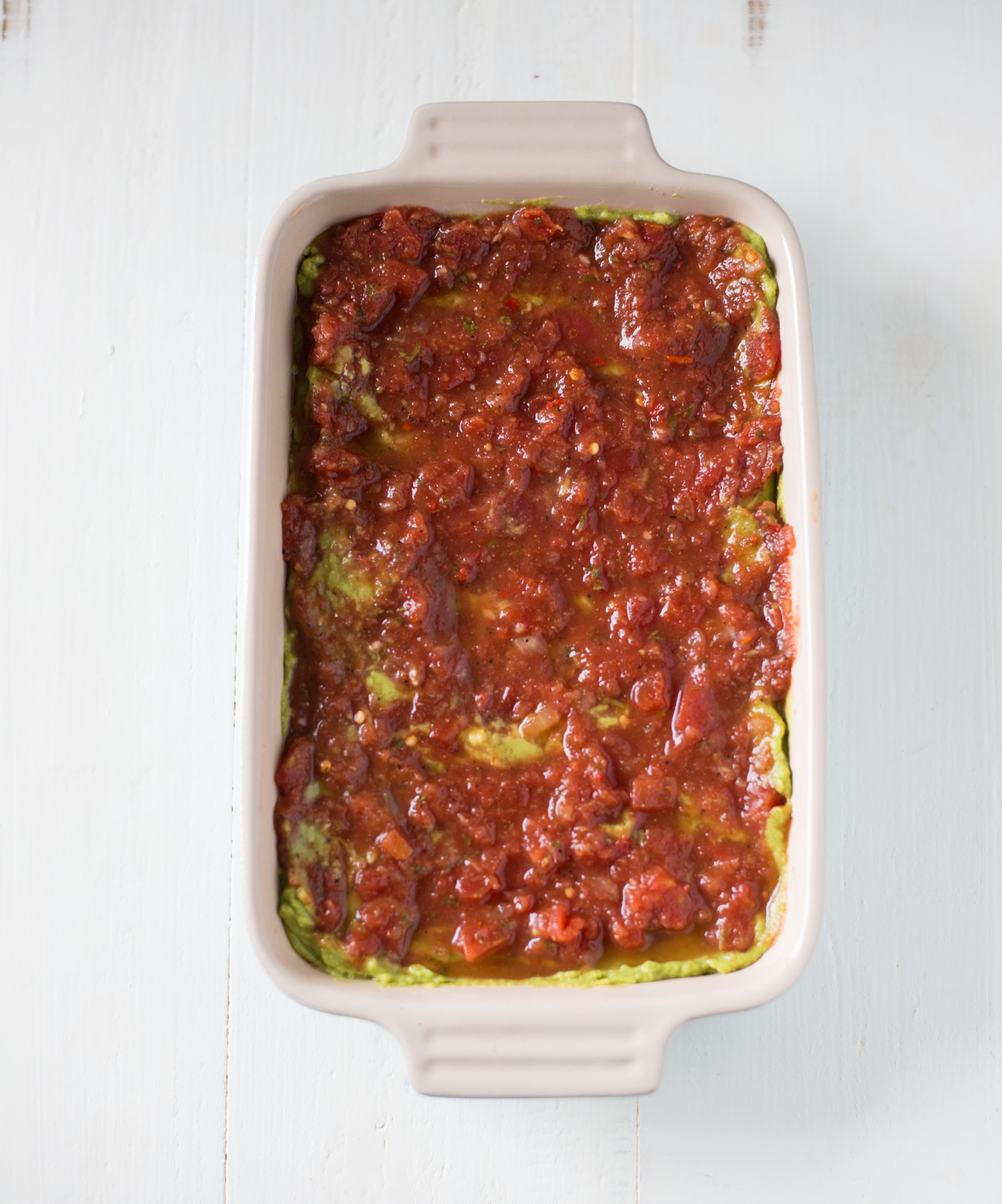 Simple, delicious, and naturally gluten-free & dairy-free, Real Food 7-Layer Dip will be the hit of your next party or gathering!