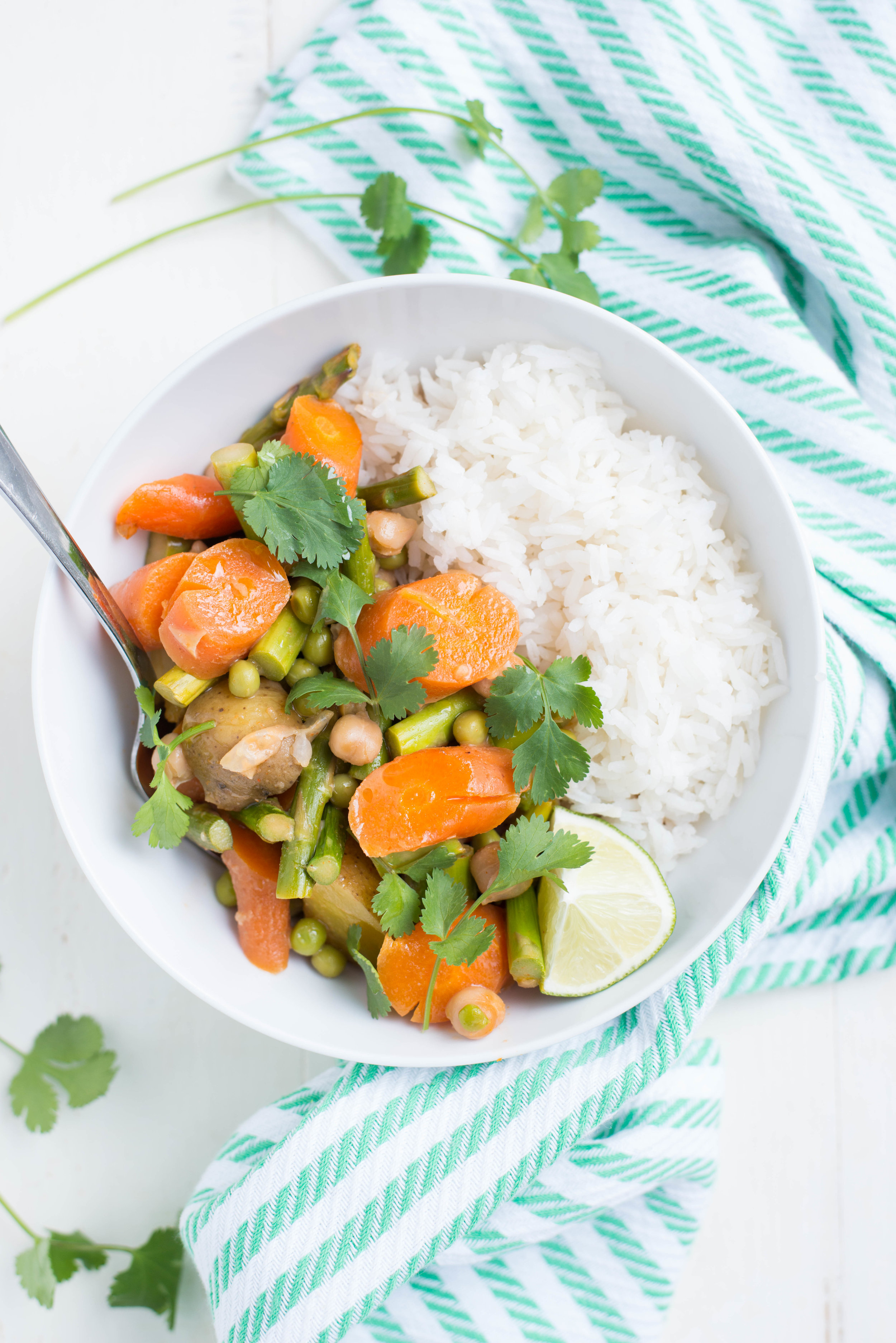 Bursting with vibrant spring vegetables, Slow Cooker Spring Veggie Coconut Curry is easy to pull together and is the perfect dinner, any night of the week.