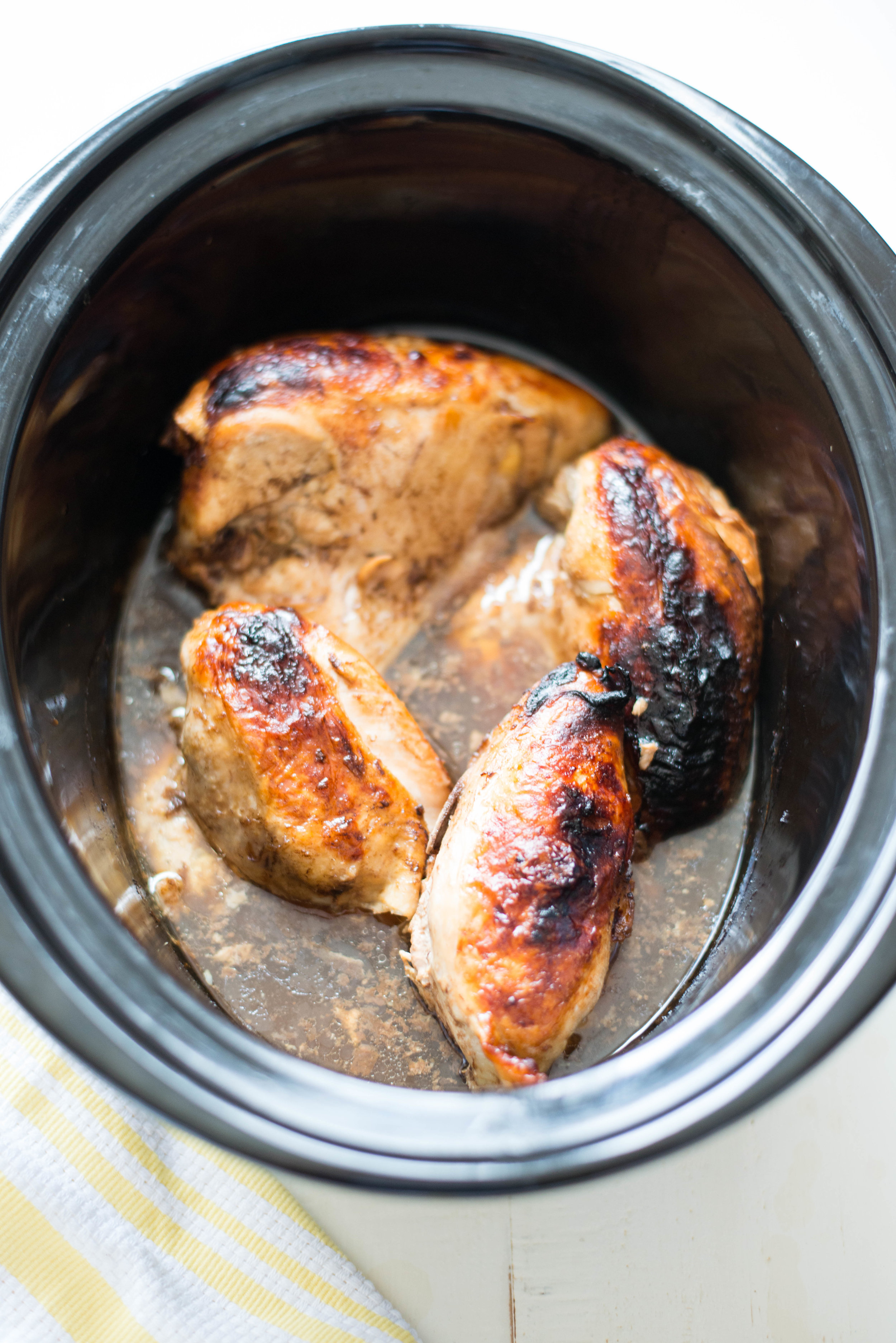 5 simple ingredients combine in juicy, succulent 5-Ingredient Slow Cooker Garlic Balsamic Chicken, an effortless dinner recipe any night of the week. healthy, paleo, whole30