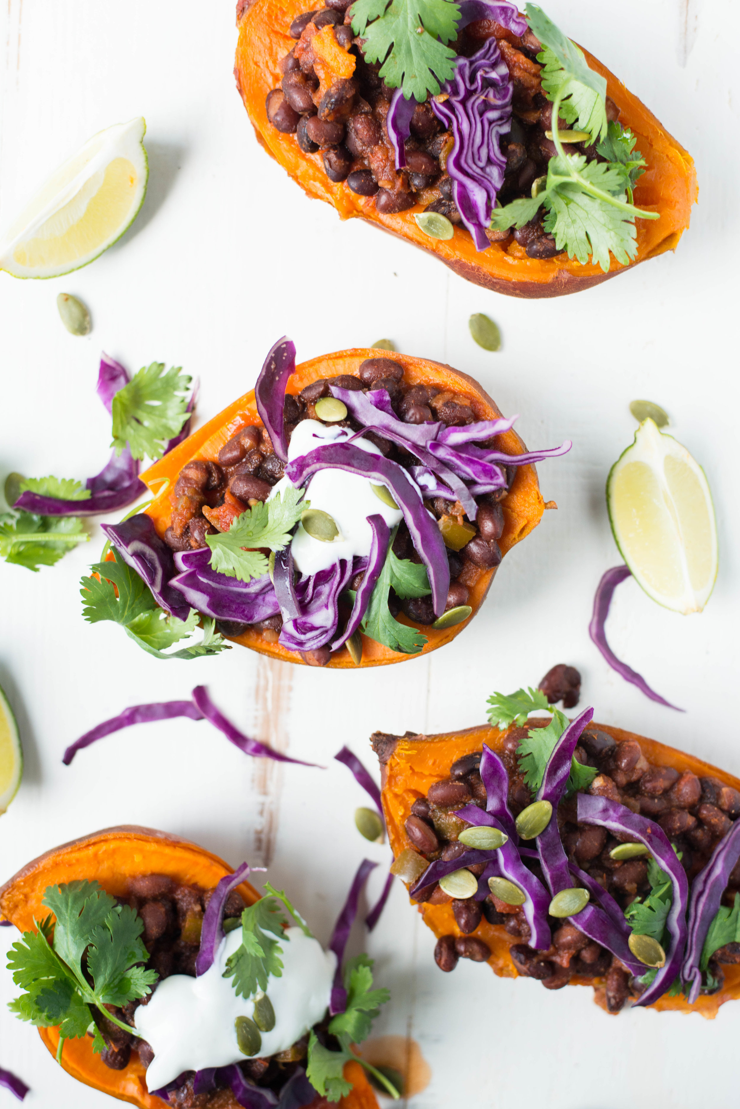 5-Ingredient Slow Cooker Black Bean Stuffed Sweet Potatoes are easy to prepare in the slow cooker and make for a filling, festive and delicious meal.