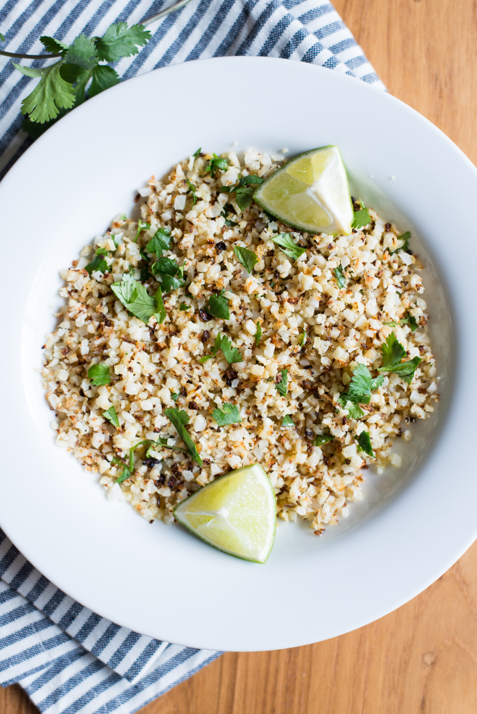 "Simple to make with minimal ingredients and just one pan, 3-Ingredient Sheet Pan Cilantro Lime Cauliflower ""Rice"" is a tasty side dish to swap for regular rice and to boost the veggies in any meal!"