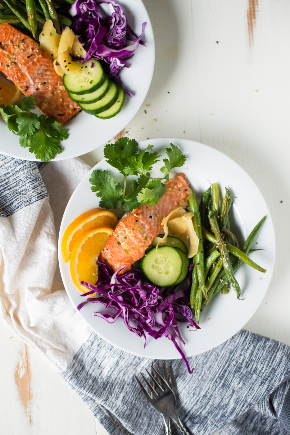 Easy, quick, incredibly delicious, and made in just one pan, Sheet Pan Ginger-Orange Salmon Bowls are just the thing for dinner tonight! Gluten-free, dairy-free, soy-free, grain-free, paleo, and Whole30 friendly.