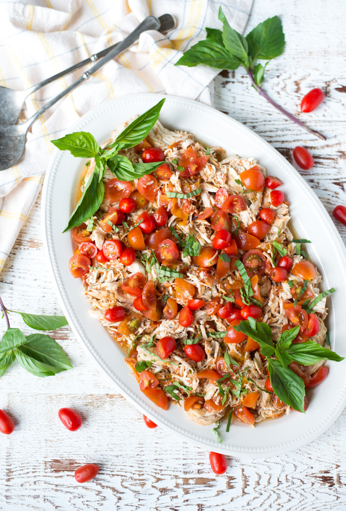 Light, bright, and perfect for summer, Slow Cooker Balsamic Tomato Basil Pulled Chicken is super easy to prepare and so delicious.