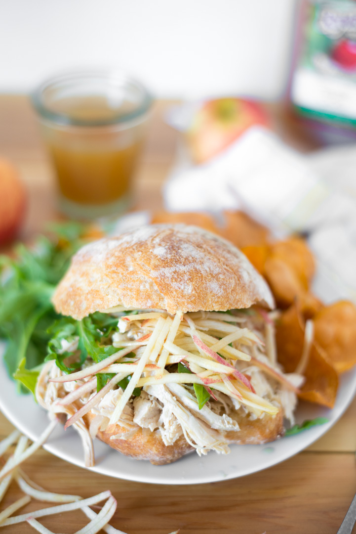 5-Ingredient Slow Cooker Apple Cider Pulled Chicken is simple to prepare and yields super tender chicken in a sweet and savory sauce that everyone in the family will love. This healthy recipe is naturally gluten-free, dairy-free, and paleo! #realfoodwholelife #realfoodwholeliferecipe #glutenfree #dairyfree #paleo #glutenfreerecipe #paleorecipe #healthy #healthyrecipe #cleaneating #grainfree #nutfree #applecider #crockpot #slowcooker #thanksgivingrecipe #healthythanksgiving #chickenrecipe #5ingredient