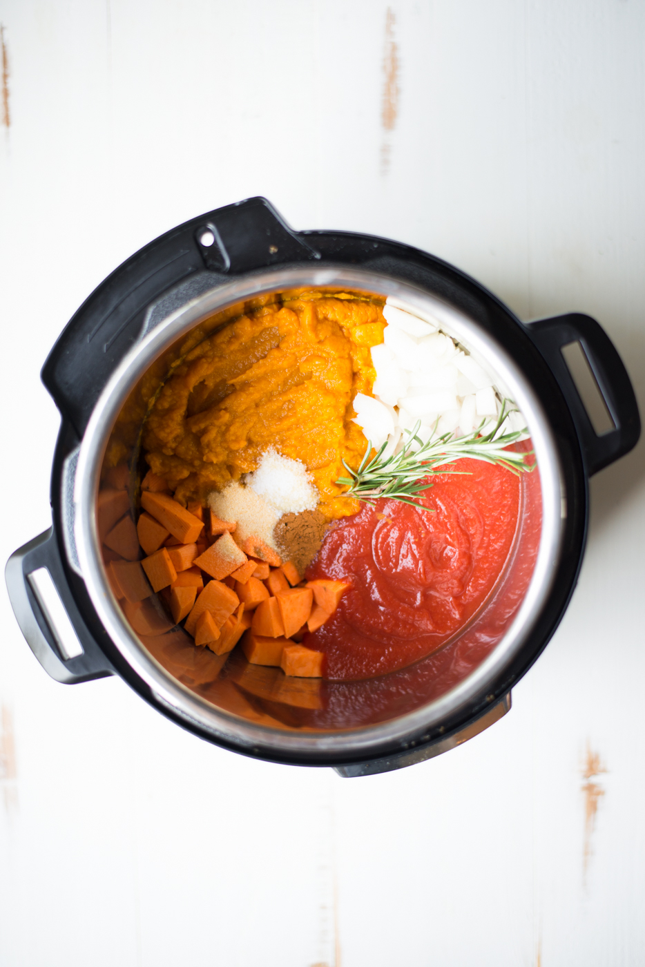 Instant Pot Creamy Pumpkin Tuscan Soup is insanely easy and totally delectable. This warming, nourishing fall recipe is gluten-free, dairy-free, paleo, and whole30. #realfoodwholeliferecipe #healthyrecipe #paleo #paleorecipe #whole30 #whole30recipe #pumpkin #pumpkinrecipe #fall #fallrecipe #cleaneating #glutenfree #dairyfree #glutenfreerecipe #dairyfreerecipe #instantpot #instantpotrecipe #vegan #veganrecipe