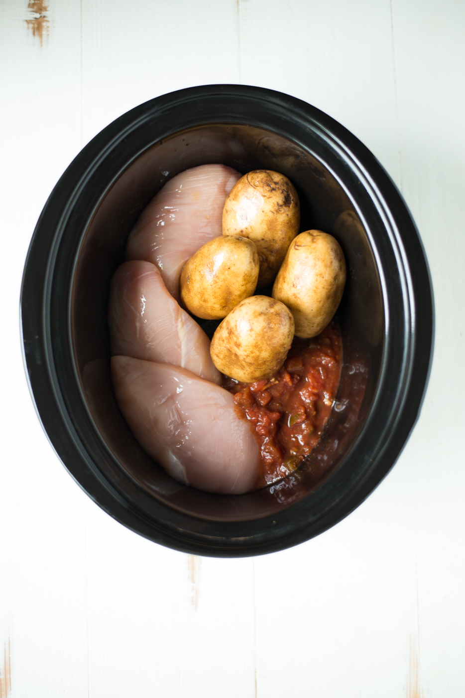 3-Ingredient Crockpot Salsa Chicken Stuffed Potatoes is the easiest, most delicious, craziest simple recipe you'll find anywhere. What's more, everything cooks at once in the slow cooker, so prep is super fast and cleanup is a breeze! A gluten-free, dairy-free, grain-free, paleo, and Whole30 friendly recipe #realfoodwholelife #realfoodwholeliferecipe #glutenfree #glutenfreerecipe #dairyfree #dairyfreerecipe #healthy #healthyrecipe #easyrecipe #quickrecipe #cleaneating #crockpot #slowcooker #crockpotrecipe #slowcookerrecipe