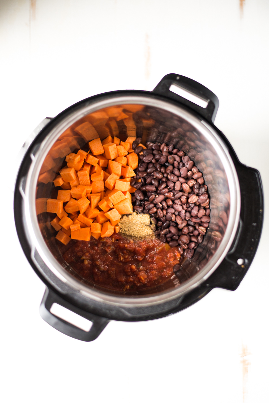 5-Ingredient Black Bean & Sweet Potato Chili is simple to prepare, totally nourishing, and absolutely delicious. Just throw a few ingredients it in the slow cooker or pressure cooker, and dinner is ready! #realfoodwholelife #realfoodwholeliferecipe #glutenfree #glutenfreerecipe #dairyfree #dairyfreerecipe #healthy #healthyrecipe #easyrecipe #quickrecipe #cleaneating #slowcooker #crockpot #instantpot