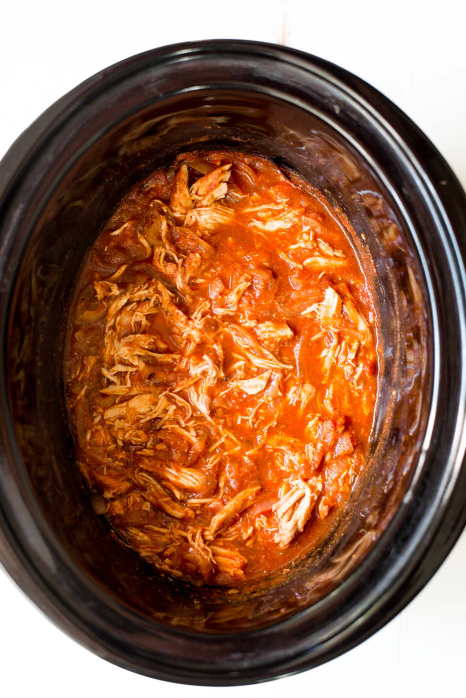 Easy and versatile 6-Ingredient Slow Cooker Enchilada Chicken is a totally simple, completely delicious weeknight crockpot recipe that everyone will love! A healthy, gluten-free, dairy-free recipe. #realfoodwholelife #crockpot #slowcooker #crockpotrecipe #slowcookerrecipe #glutenfree #dairyfree #whole30