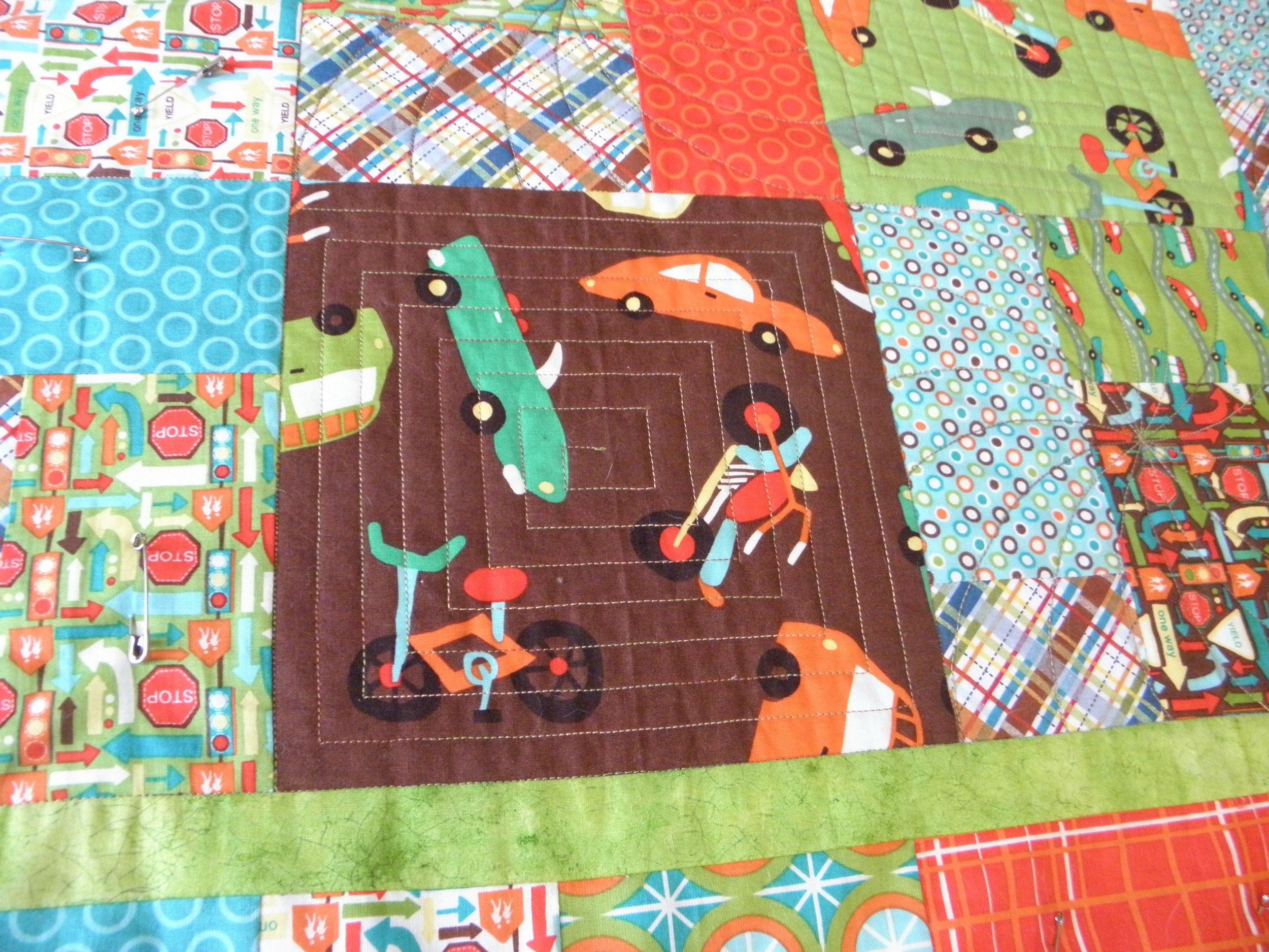 The quilting on the solid square blocks.