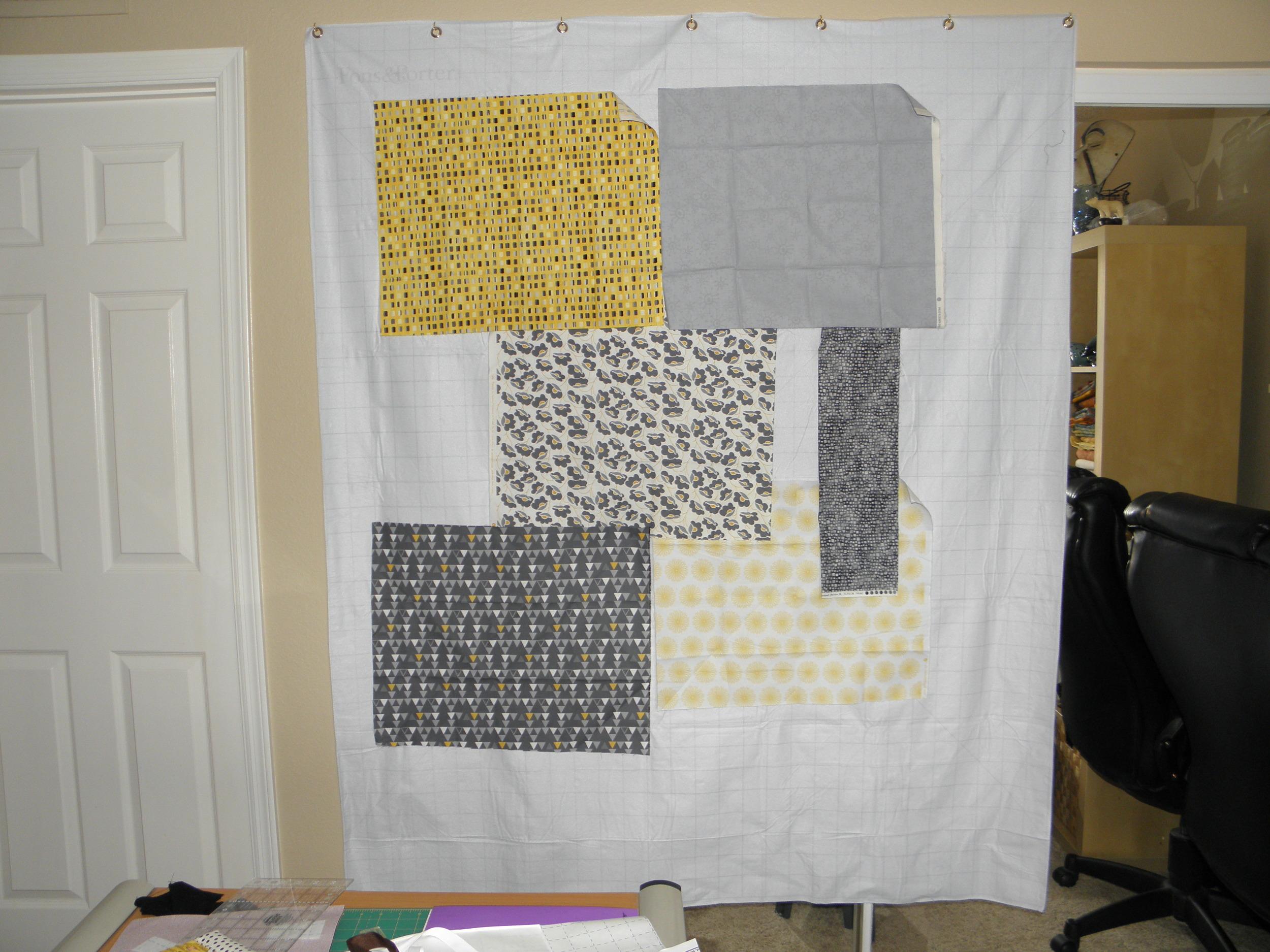 Auditioning fabrics on the design wall.