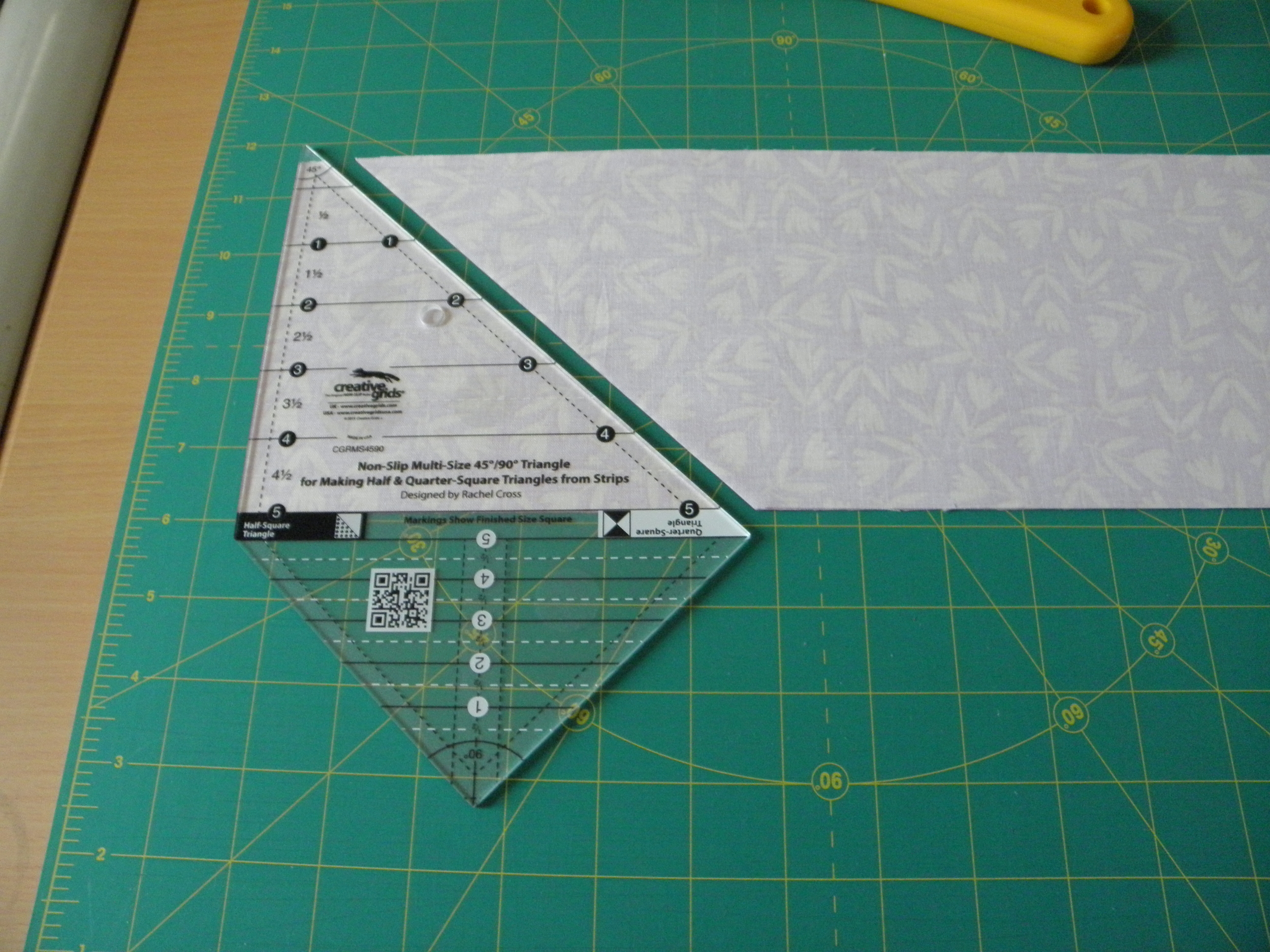 Line up the strait side of ruler to trimmed edge of strip set.