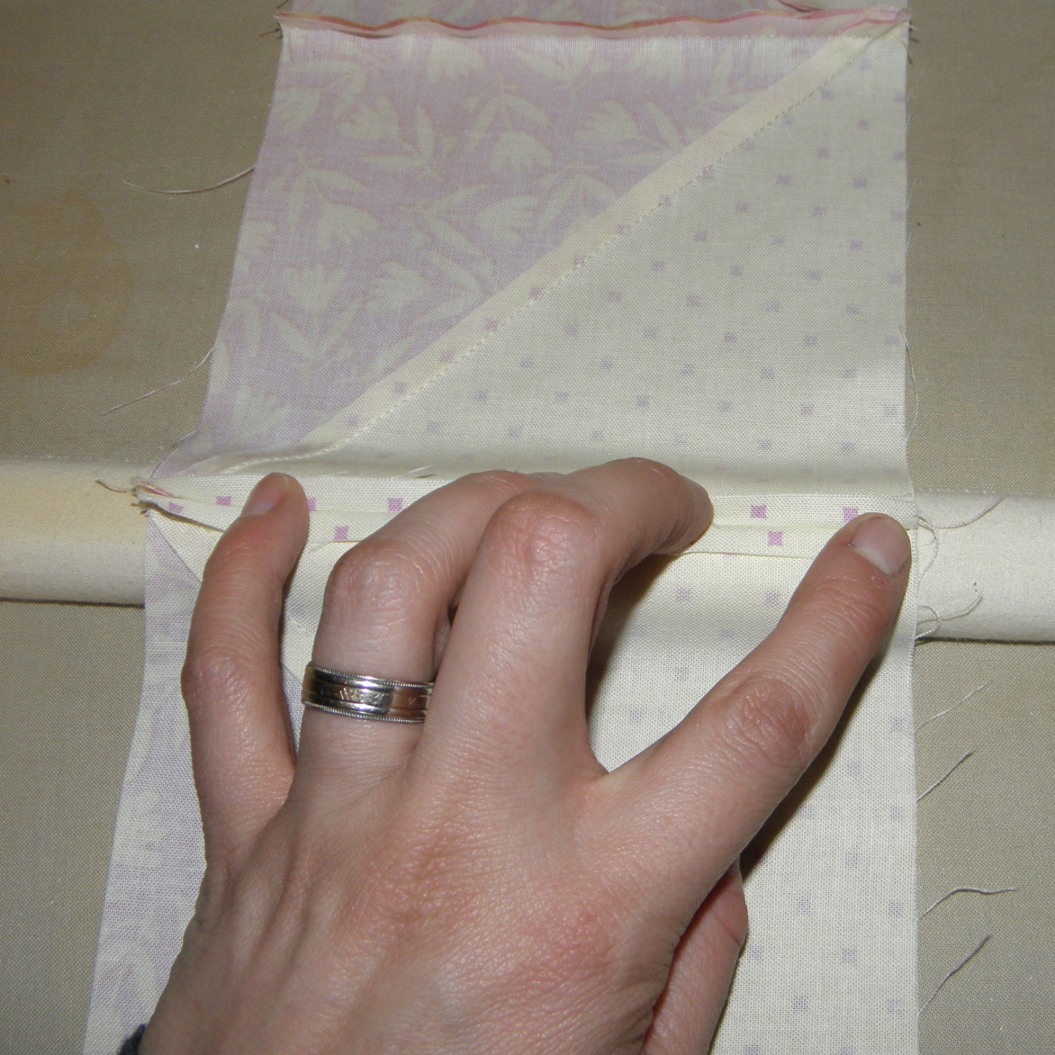 Open the seam with your fingers before pressing.