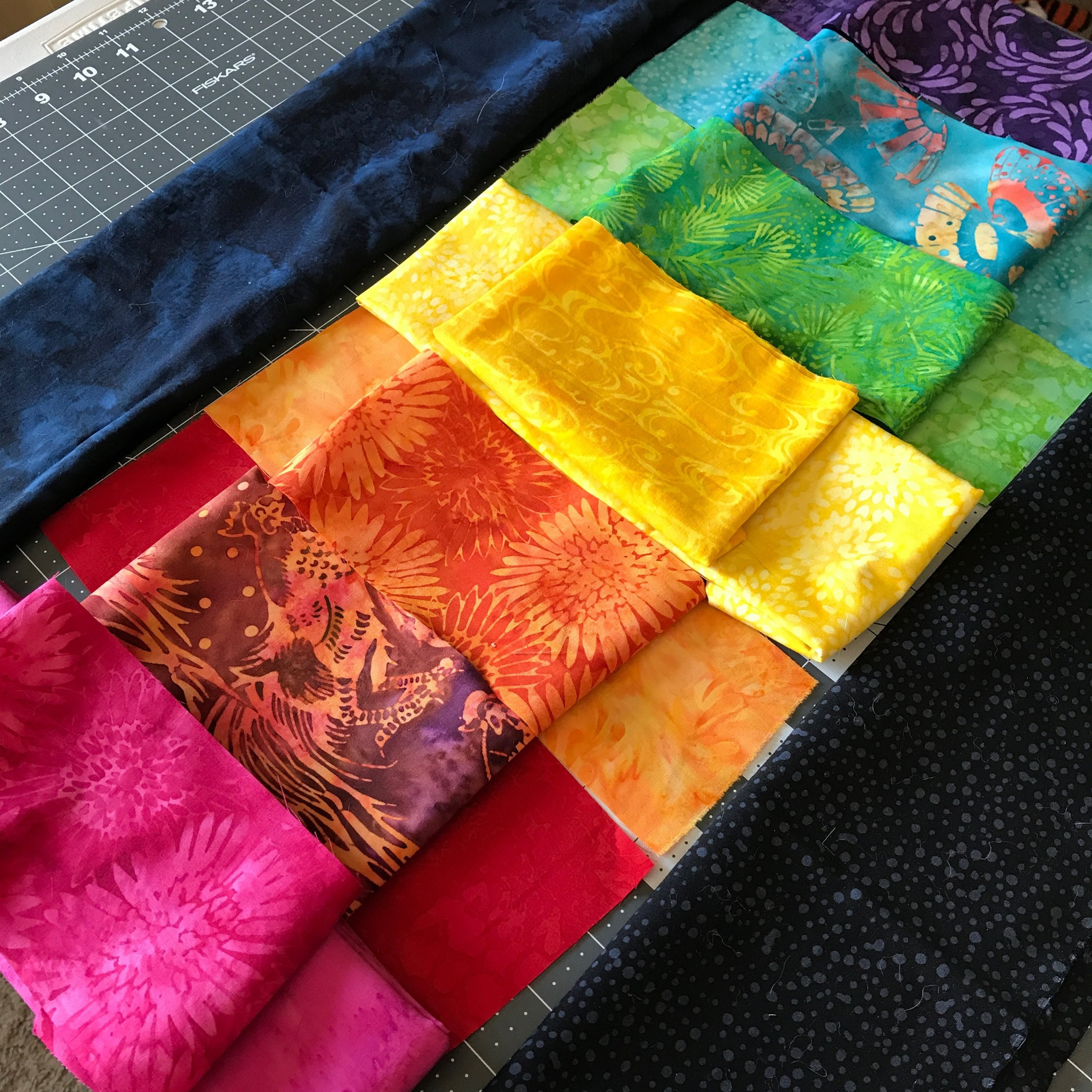 Trying out fabrics before cutting.