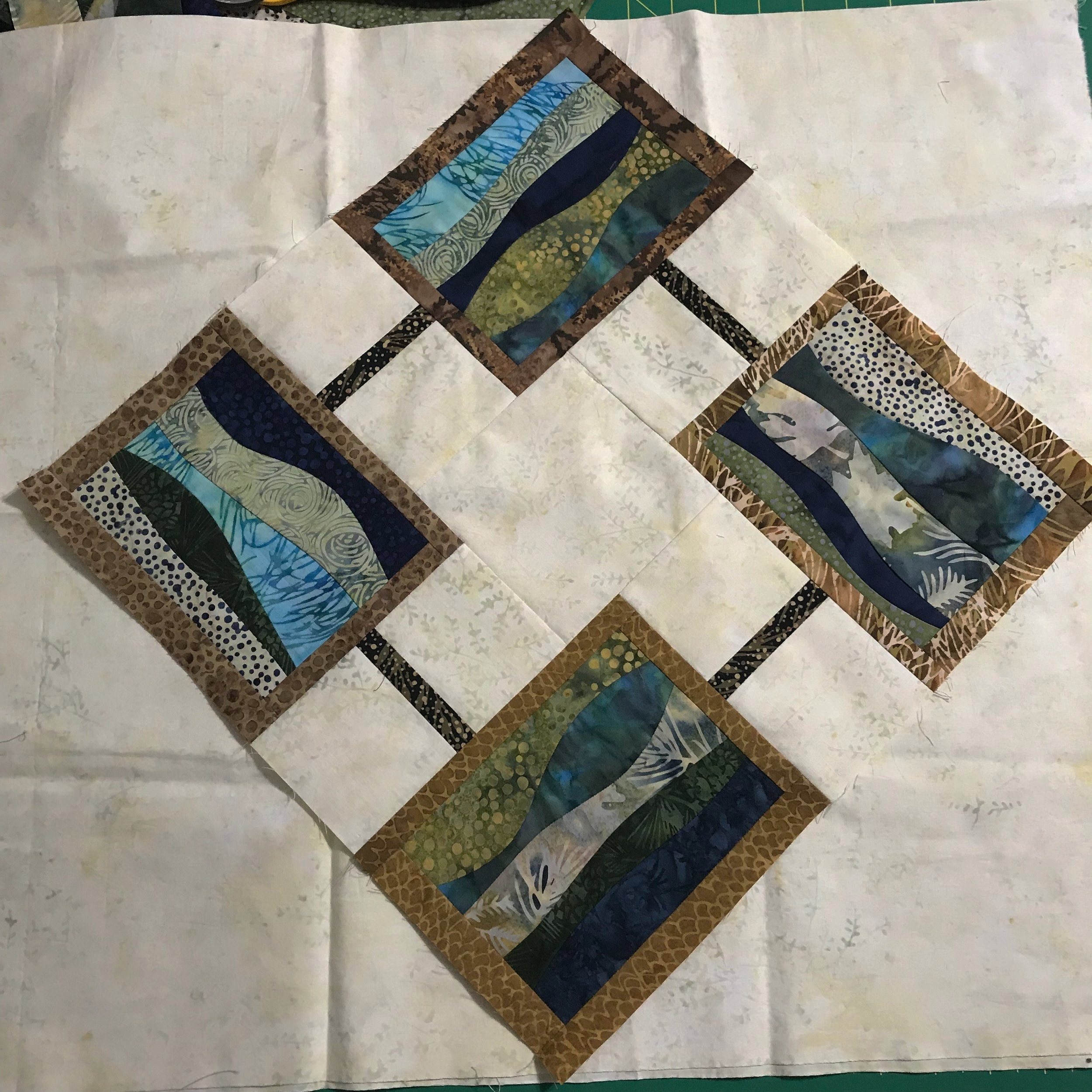 """Quilt laid out on point. Final measure would be 22"""" square."""