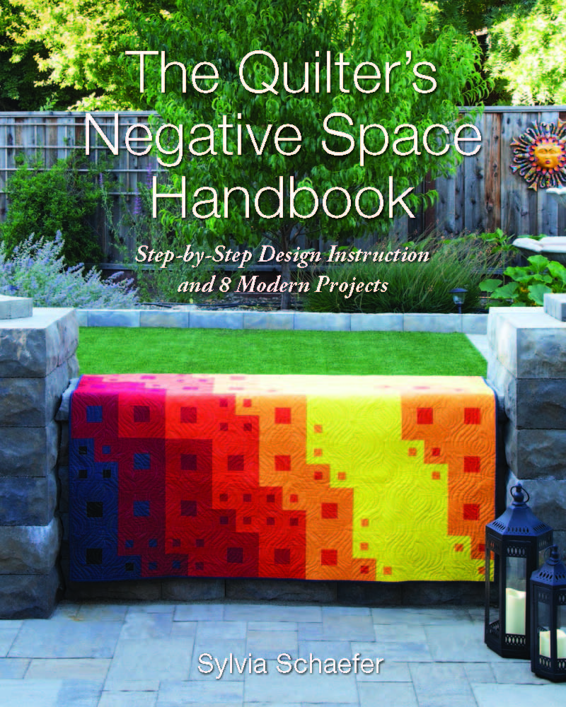 The Quilter's Negative Space Handbook Cover.jpg