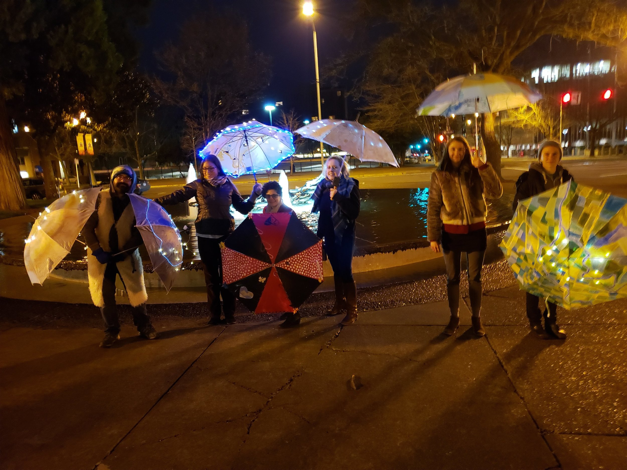 Wanderlust Umbrella Project ArtCity   February 19th, 2019  The Umbrella Project embraces the rain and the darkness of winter by illuminating and transforming Downtown Eugene with an ever-changing display of live, time-based art.  The Umbrella Project is presented by ArtCity Eugene and  Cultural Services, City of Eugene.      Upcoming     Umbrella Project     Appearances    Wanderlust  February 19, 5:50-6:50 pm   Nimbus  February 20, 5:50-6:50 pm   Zoe Troupe  February 22, 5:50-6:50 pm   Vanessa Fuller Dance  February 25, 5:50-6:50 pm   David CP & Apprentices  February 26, 5:50-6:50 pm   Vanessa Fuller Dance  February 27, 5:50-6:50 pm   The Umbrella Auction  March 1, 6:30-7:30 pm  / Kesey Square    Keep an eye out for your favorite umbrella. All umbrellas will be auctioned on Friday, March 1 in Kesey Square during the First Friday ArtWalk. Umbrella proceeds will benefit    15th Night   , participating artists, and ArtCity Eugene (40-40-20)