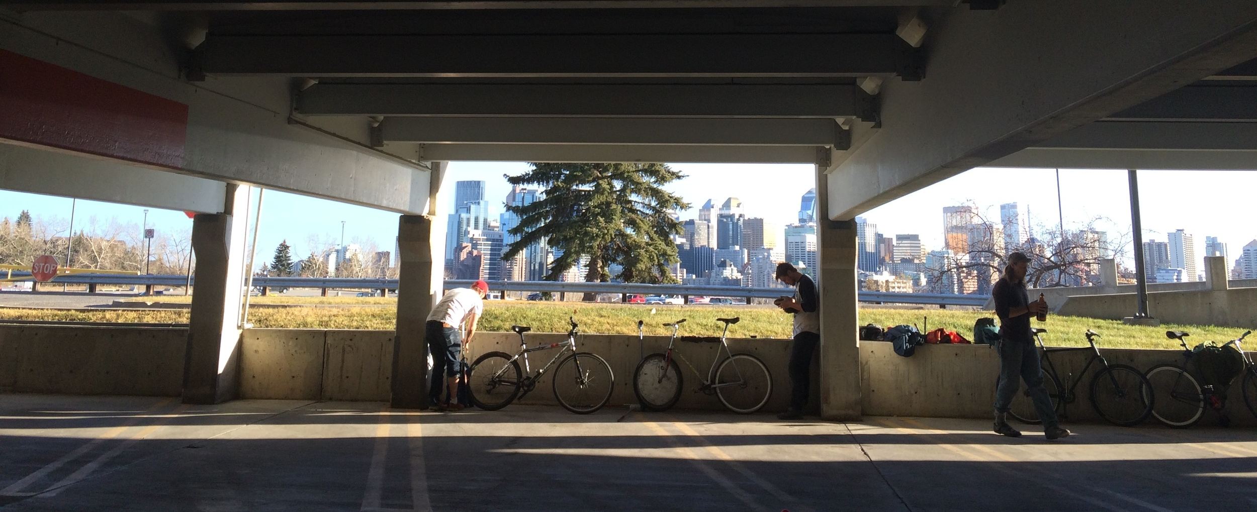 Photo:   Getting ready to play some bike polo at Alberta College of Art and Design while soaking in the views of downtown Calgary.