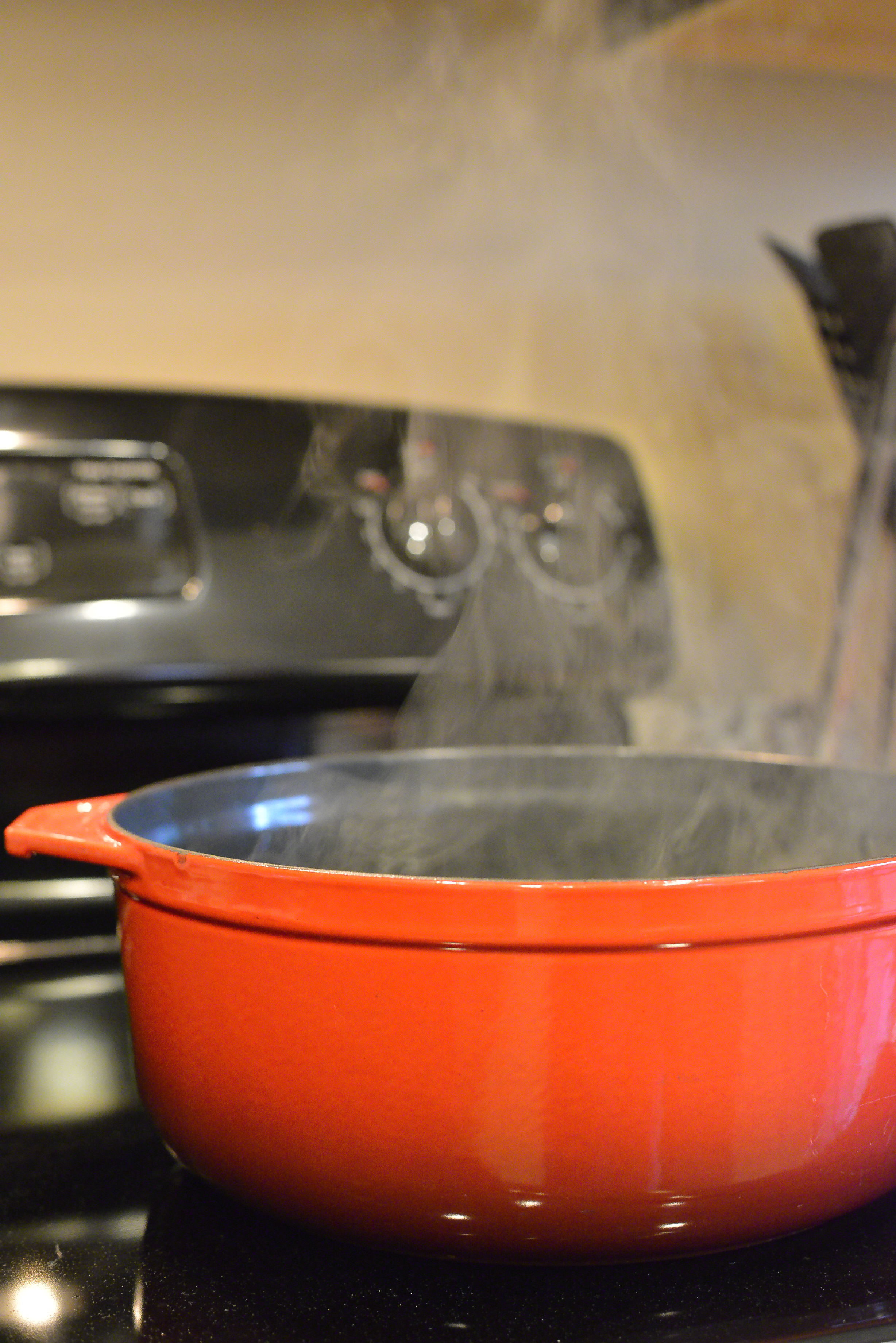Beautiful pot of soup cooking on the stove.