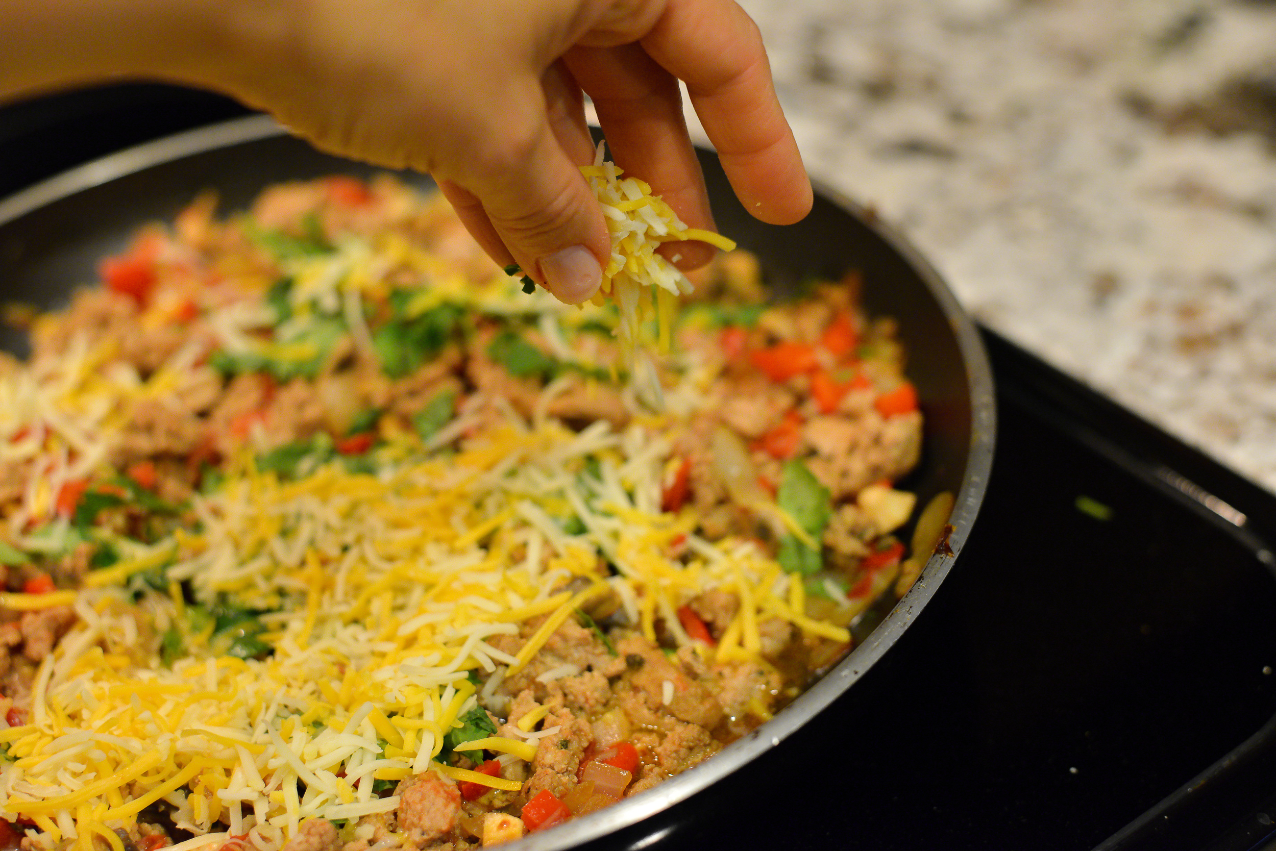 Top this lean meat and vegetable mix with your favorite cheese. I use a shredded Mexican mix. Going with part-skim varieties will help save you some calories.
