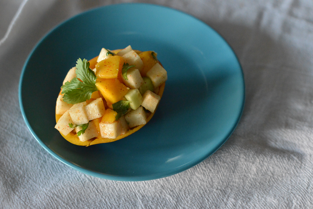 A fun way to plate this salad is inside of a shelled-out mango peel.