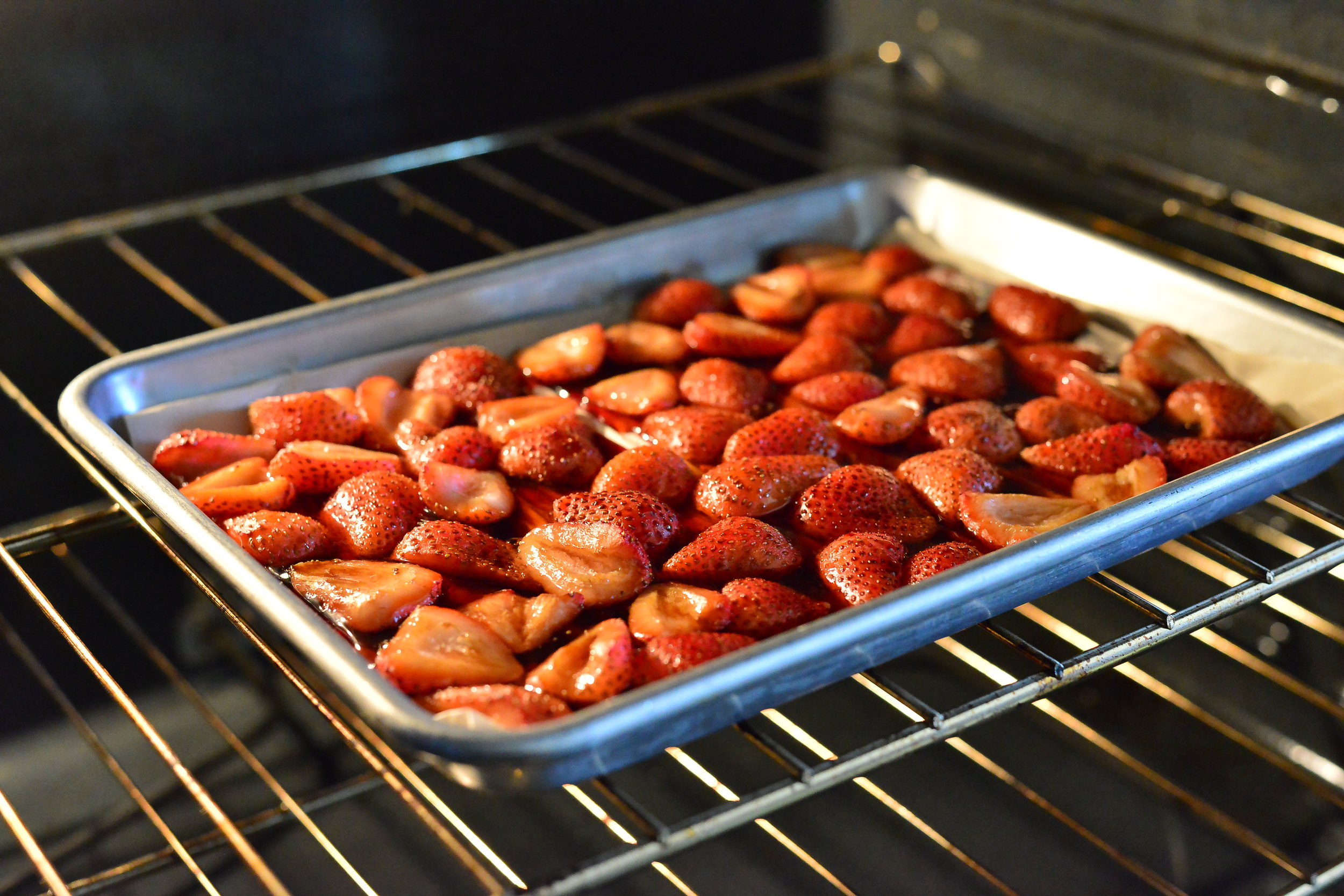Roasting strawberries that have been dressed with honey and balsamic reduction brings out a rich, sweet flavor. A must try!