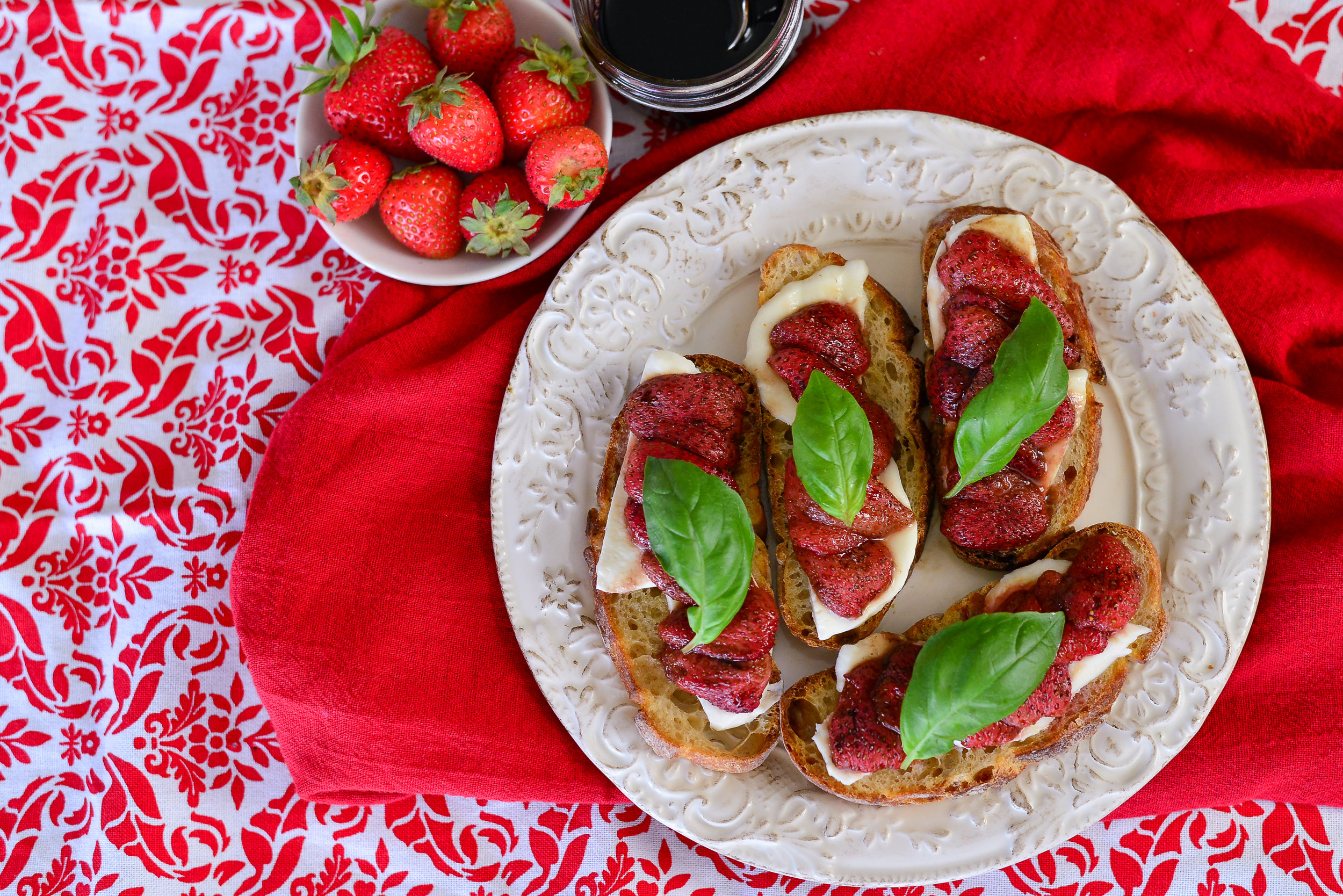 Roasted Balsamic Strawberry Toasts with Mozzarella for the holiday table win! Head over to  Heart of Farmers  for the recipe.