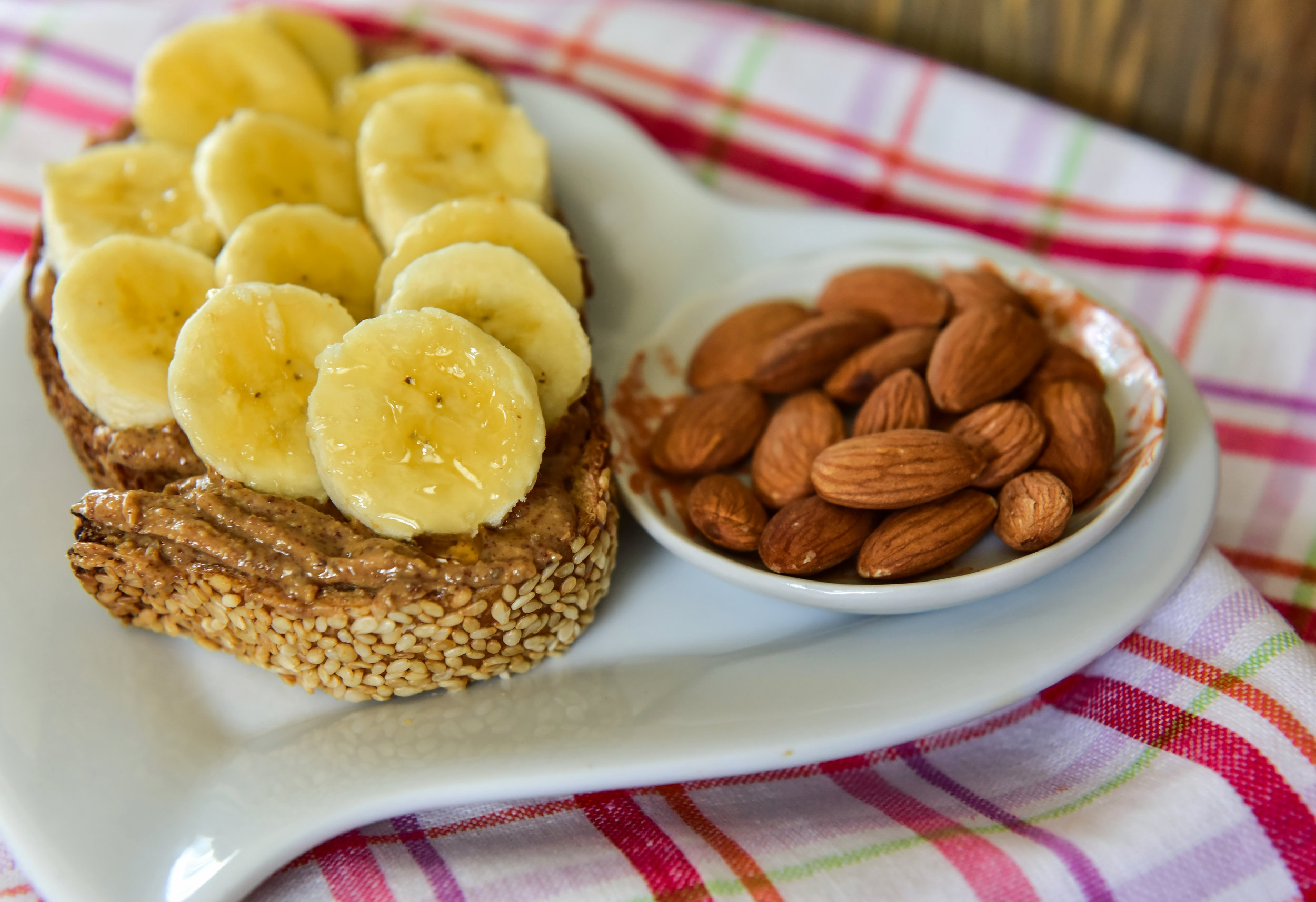 Sliced banana with almond butter on Whole Wheat Sesame Seed Barrio Bread™