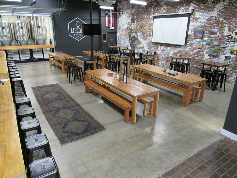 DAYTIME: LOUNGE AREA LOOKING INTO TAPROOM SEATING