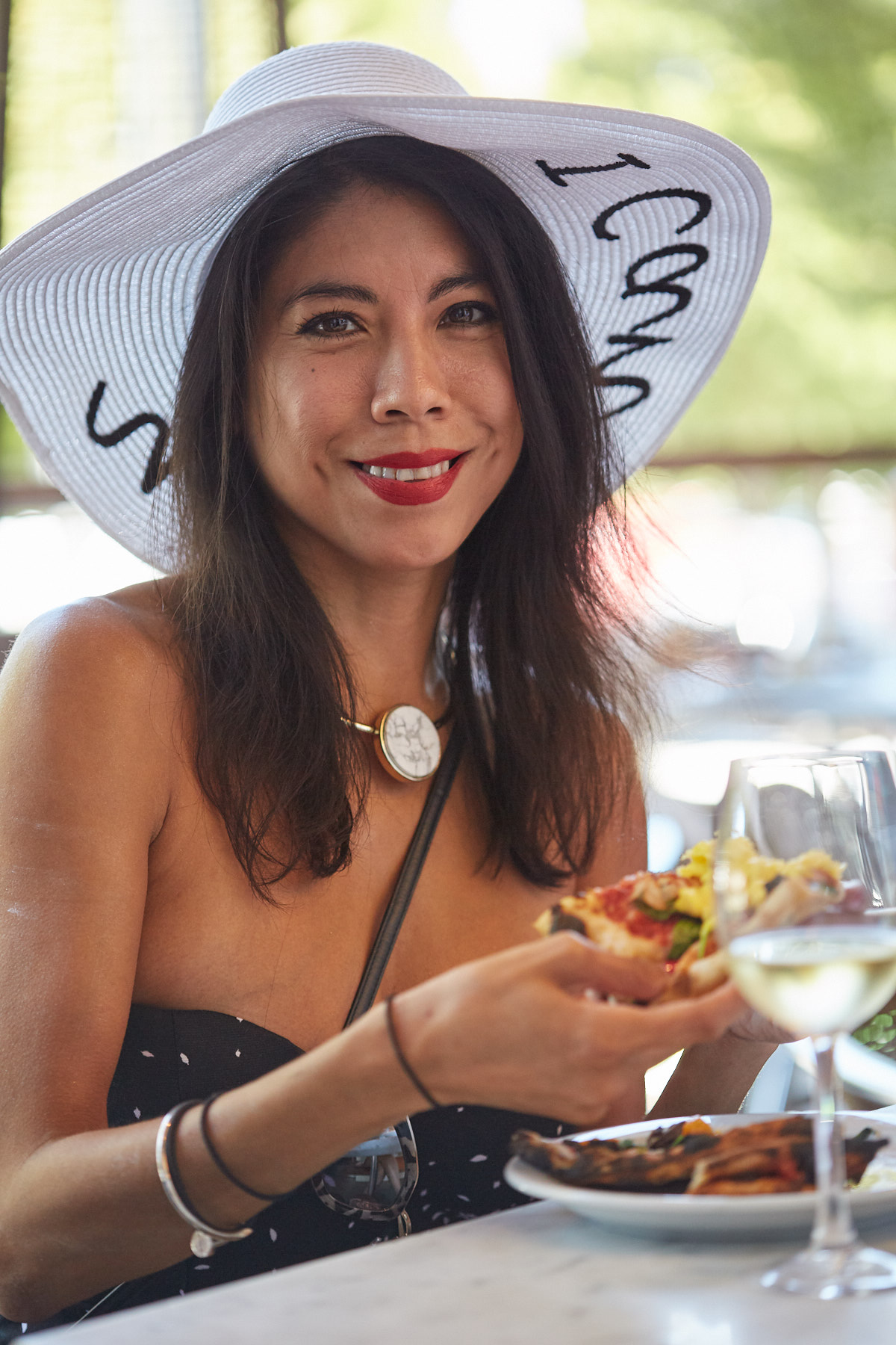 A guest enjoying herself at a Live Fire Pizza Oxbow Market event.