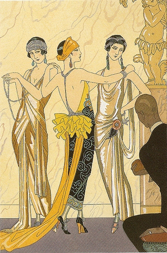 Three women dressed in 1920s art deco attire and accessories at a party