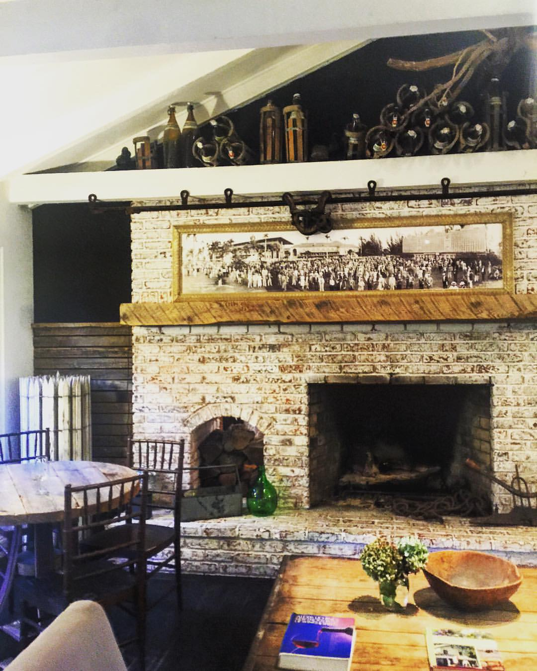 How nice will this fireplace be this fall? 🔥🔥🔥 || #rustic #modern #fireplace #fall #ny #hamptons #northfork #wineries #vineyard #design #brick #wood #openhouseny