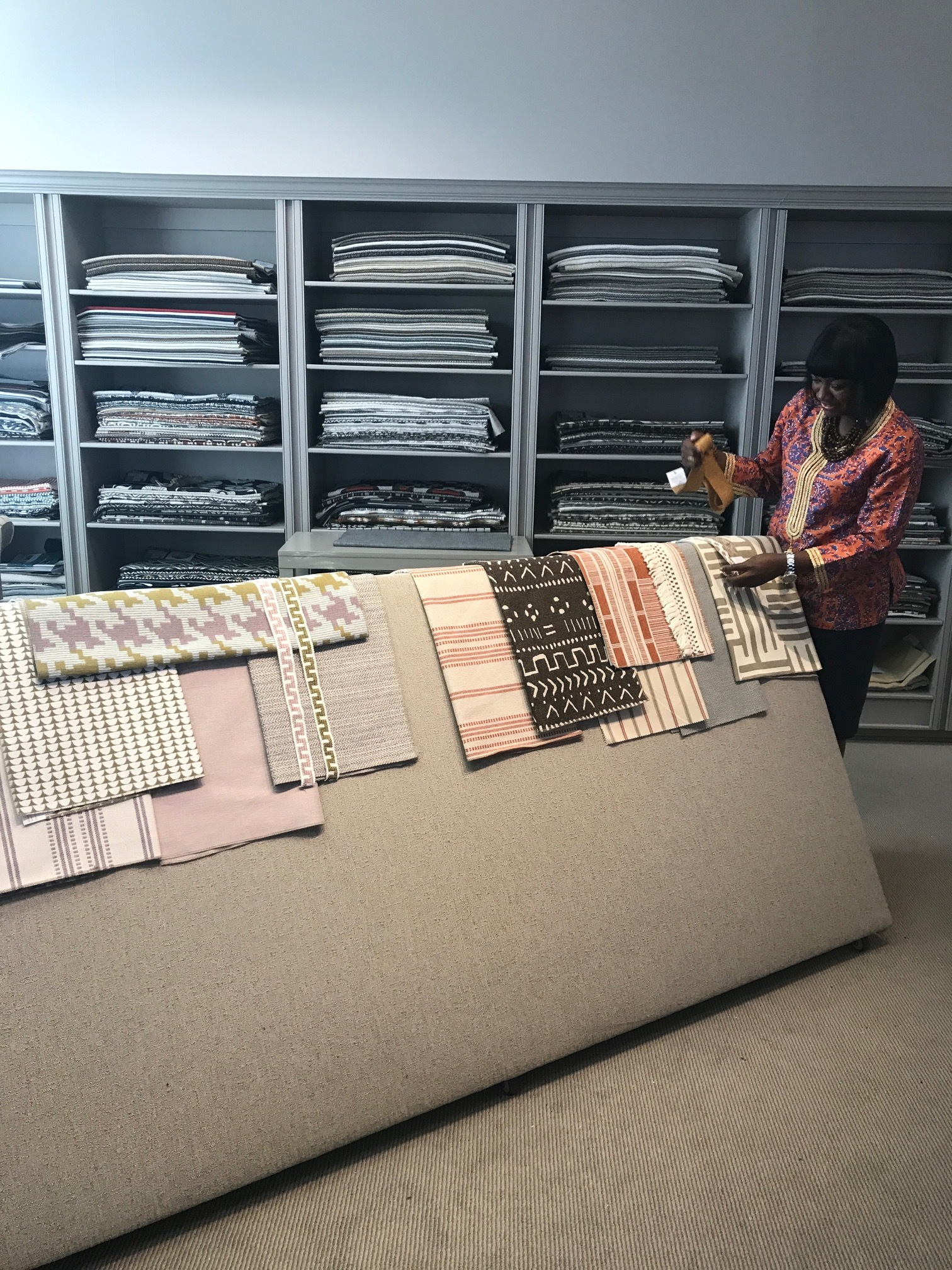 Cheryl Luckett, interior designer and owner Dwell by Cheryl, is the newest addition to the Revolution team. Cheryl is shown here putting together some correlates of Revolution fabrics to show our interior design customers!