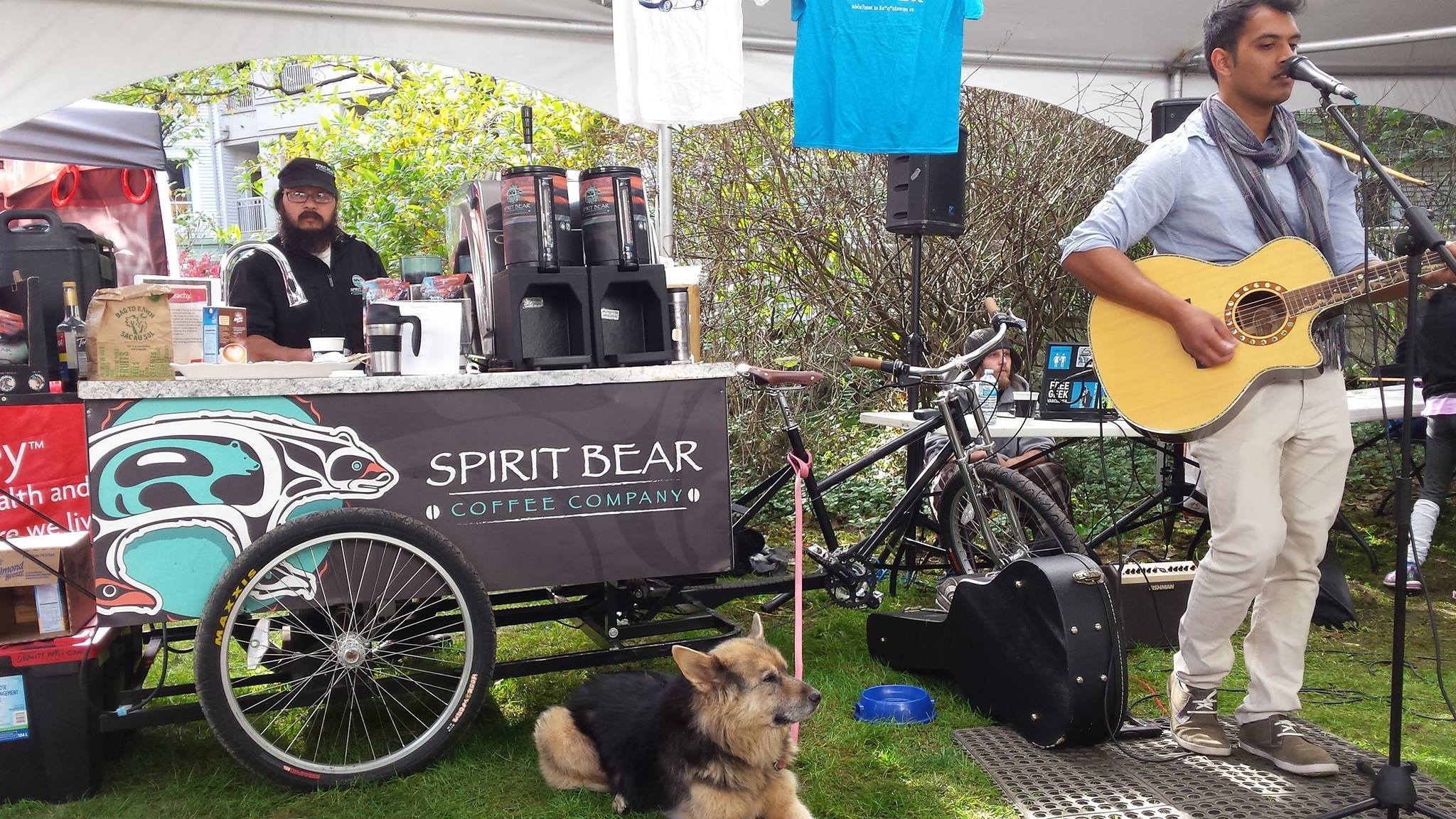 Jay Peachy serves up Spirit Bear coffee while Etienne Siew performs.