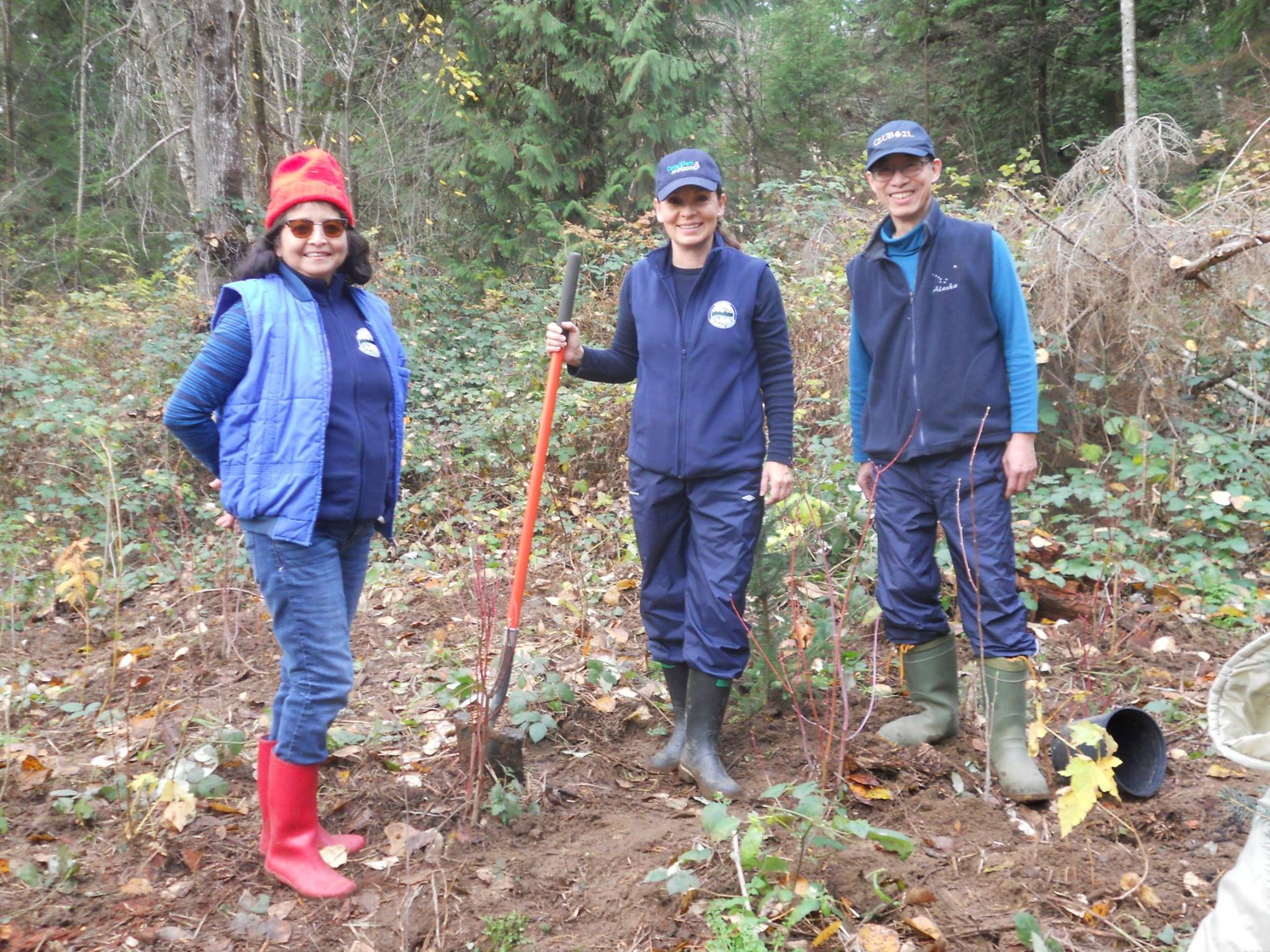 HSWS volunteers, Dulce, Robbin and Edmond in the planted area