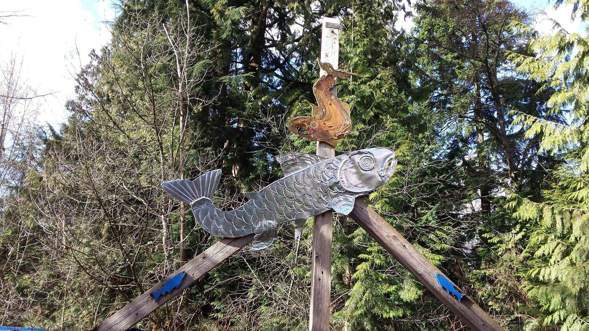 High above the rearing pond by Hoy Creek is two prominent metal art fixtures by Patricia Gaspar.