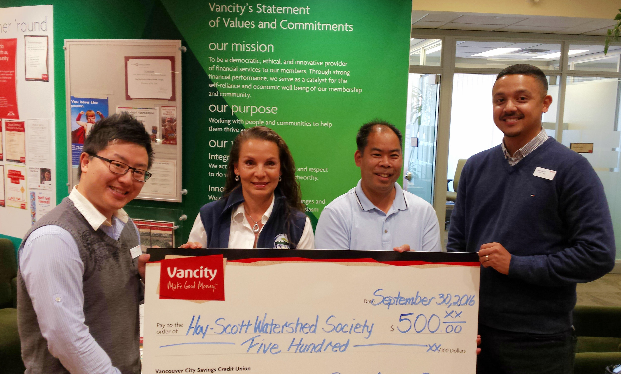 From left to right: Andy Leong CFP, Vancity Branch Business Account Manager; Robbin Whachell, President, HSWS; Kyle Uno, Treasurer HSWS; and Omar Ganief, Assistant Branch Manager, Vancity Pinetree Community Branch.
