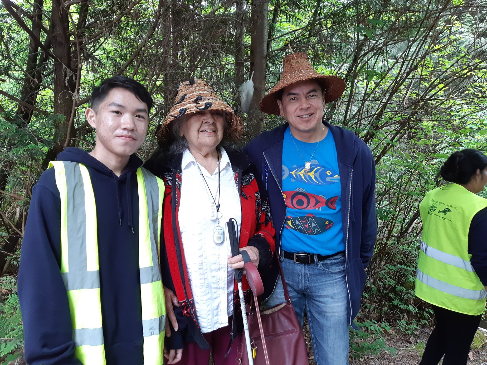 Salmon Leave Home 2019 at Hoy Creek Hatchery - Left to right: Pinetree student, Lucas; Elder Beverly and Chief Ed Hall of  Kwikwetlem First Nation . (Photo: HSWS)