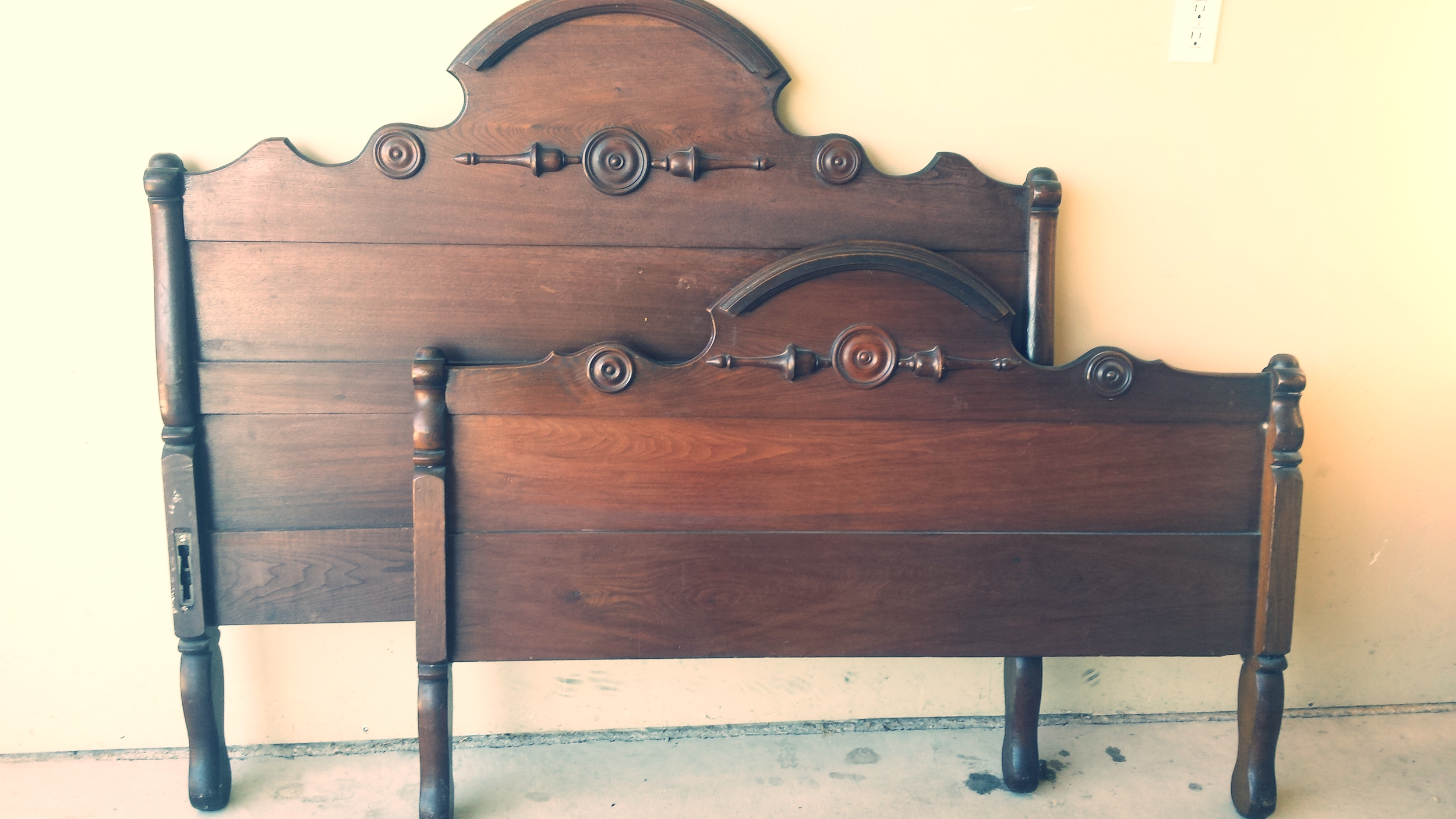 Antique head board/foot board in its original dark finish above....painted and distressed with chalk paint to achieve a new look below......