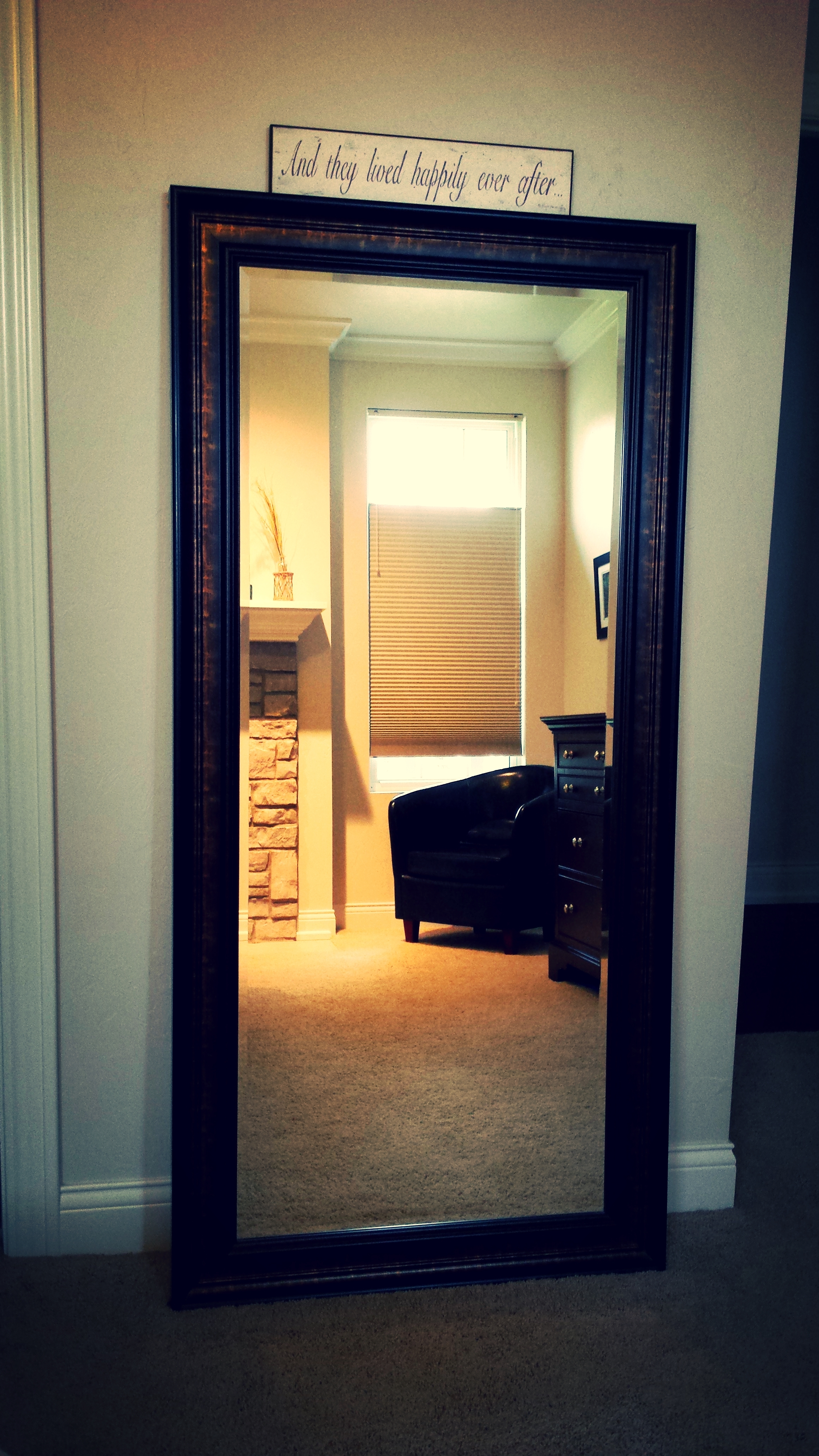 Mirrors are a great way to create the illusion of a larger space. This large mirror is functional, and serves a design purpose! Love when decor can do both!