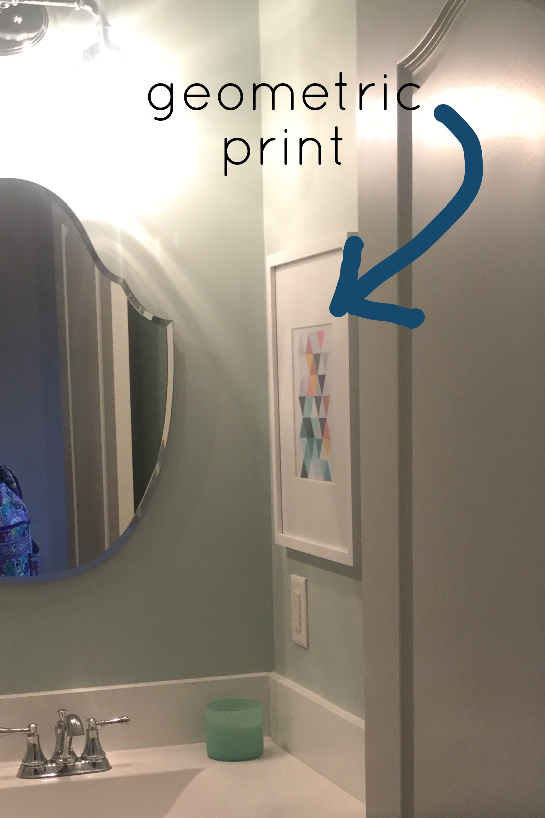 A bit difficult to see it, but, there is a great geometric print hanging to the right of the mirror. See it? (follow giant arrow)