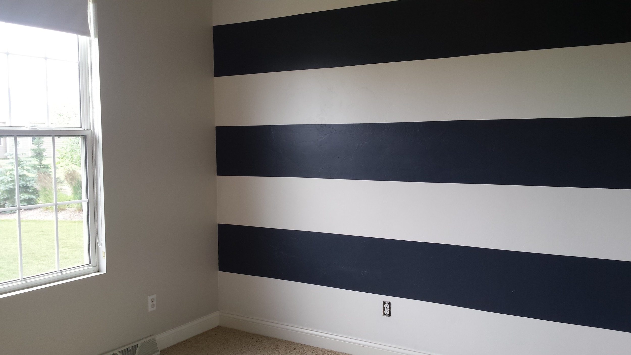 Wall on left:  Smooth Stone (Sherwin Williams). Wall on right: Ultra White (Behr) & Hale Navy (Benjamin Moore).  Since our area doesn't have a Ben Moore, I had the paint color matched to Hale Navy at Sherwin Williams.