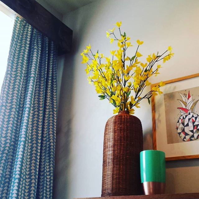I'll be using this large wicker vase and the yellow flowers in the family's porch area